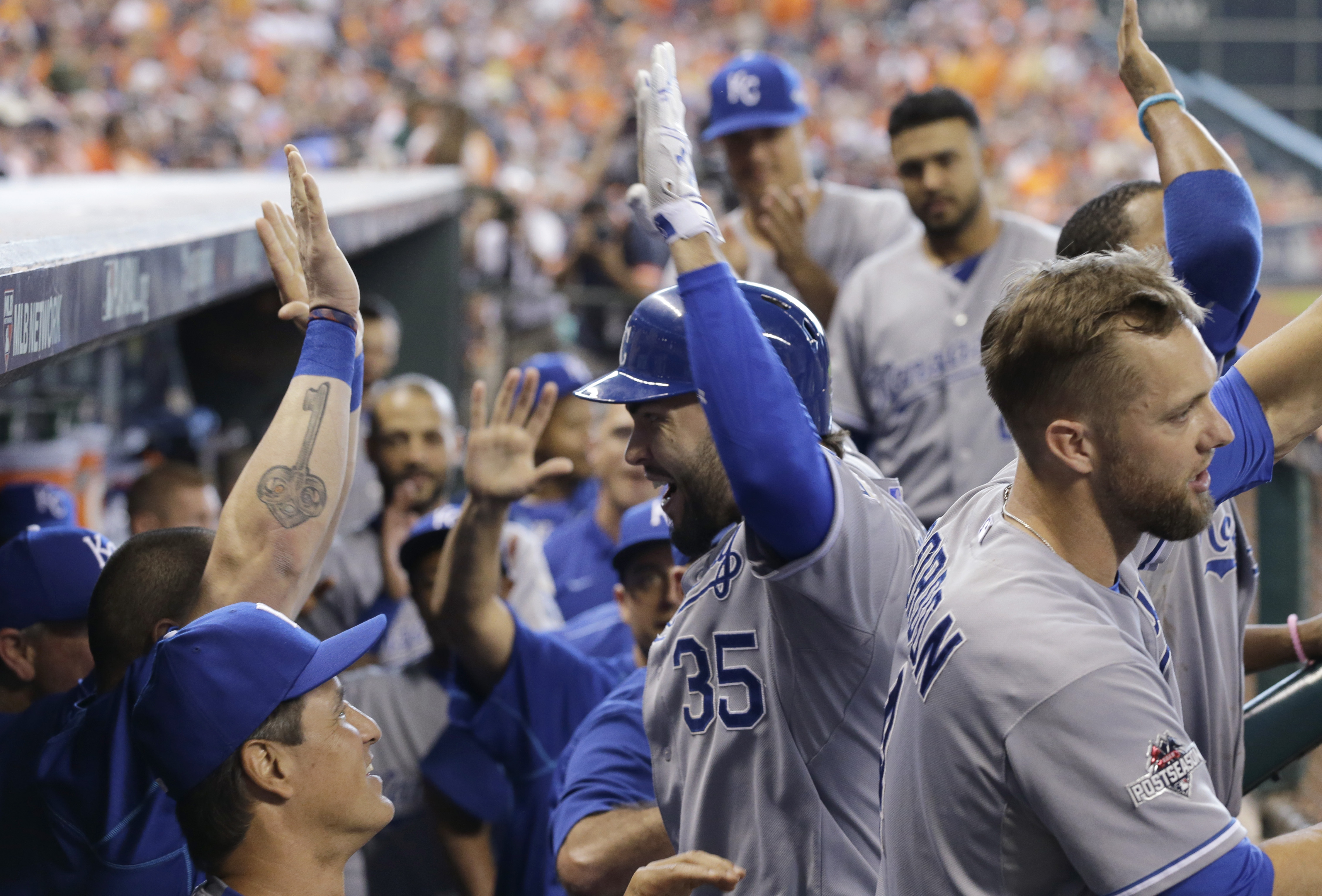 Kansas City Royals' Eric Hosmer, center, celebrates with teammates after his two-run home run against the Houston Astros in the ninth inning during Game 4 of baseball's American League Division Series, Monday, Oct. 12, 2015, in Houston. (AP Photo/David J.