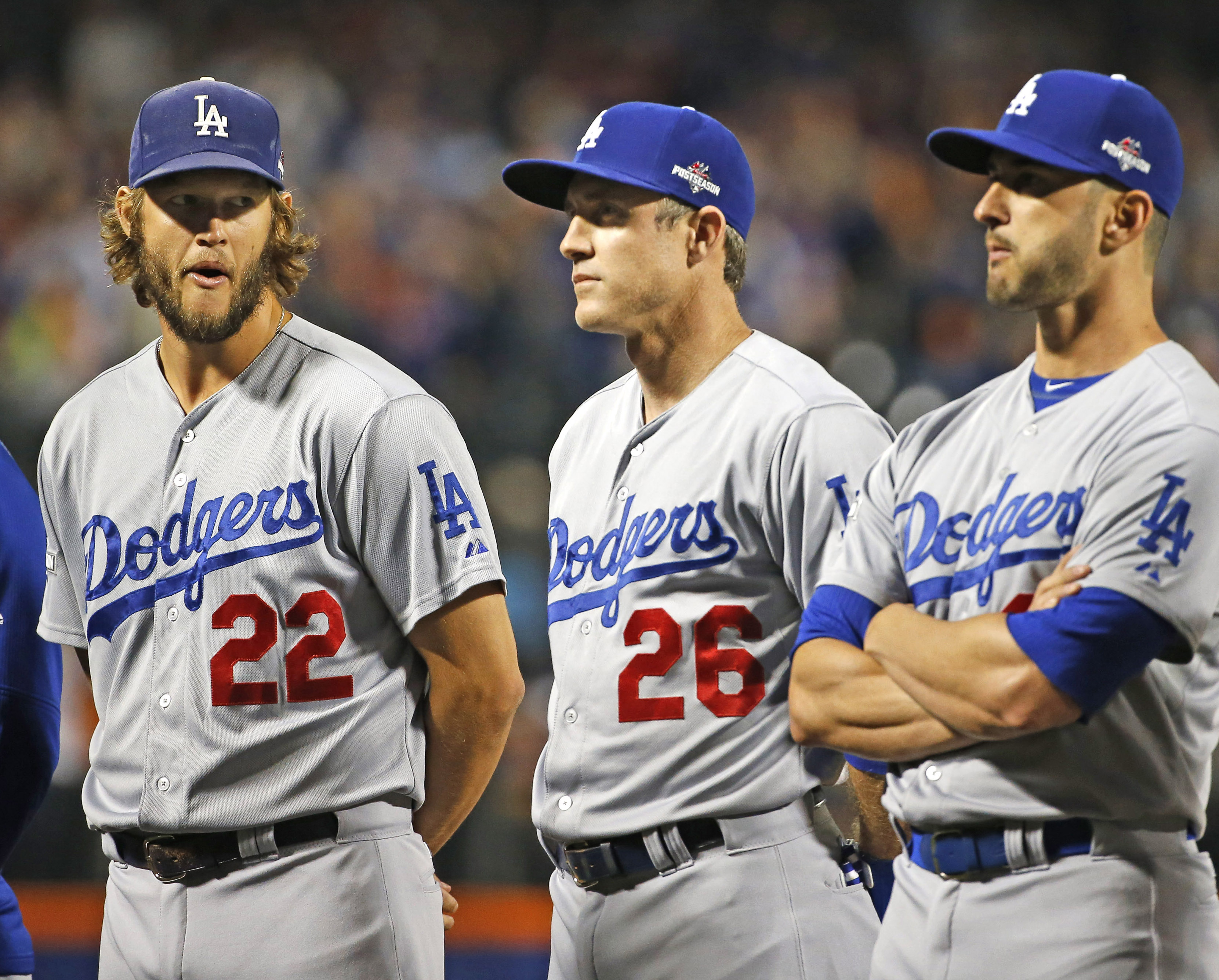 Los Angeles Dodgers pitcher Clayton Kershaw (22) glances at Los Angeles Dodgers' Chase Utley (26) as the crowd boos Utley during baseline introductions for baseball's Game 3 of the National League Division Series against the New York Mets, Monday, Oct. 12