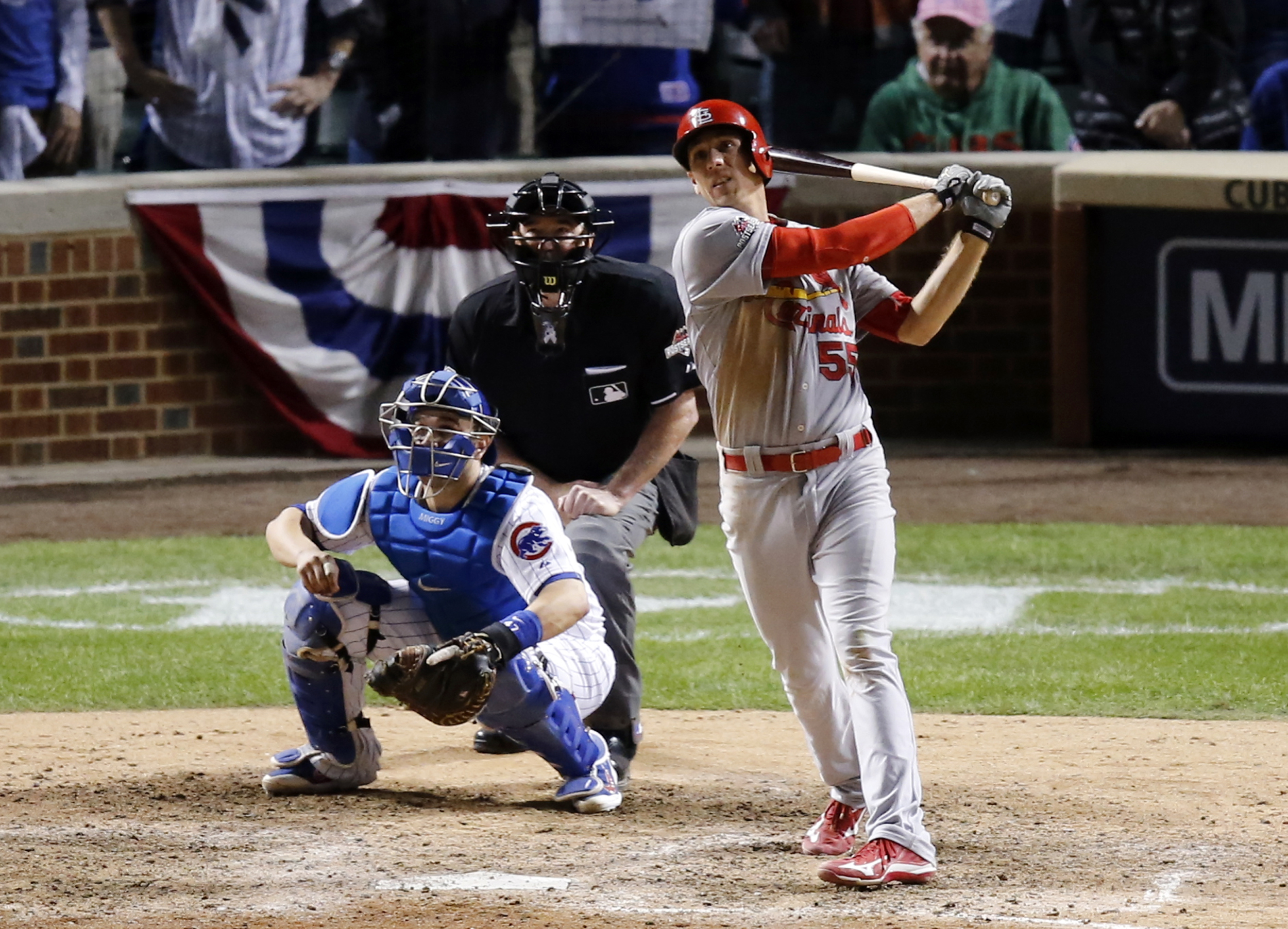 St. Louis Cardinals' Stephen Piscotty (55) hits a home run against the Chicago Cubs during the ninth inning of Game 3 in baseball's National League Division Series, Monday, Oct. 12, 2015, in Chicago. The Cubs won 8-6. (AP Photo/Charles Rex Arbogast)