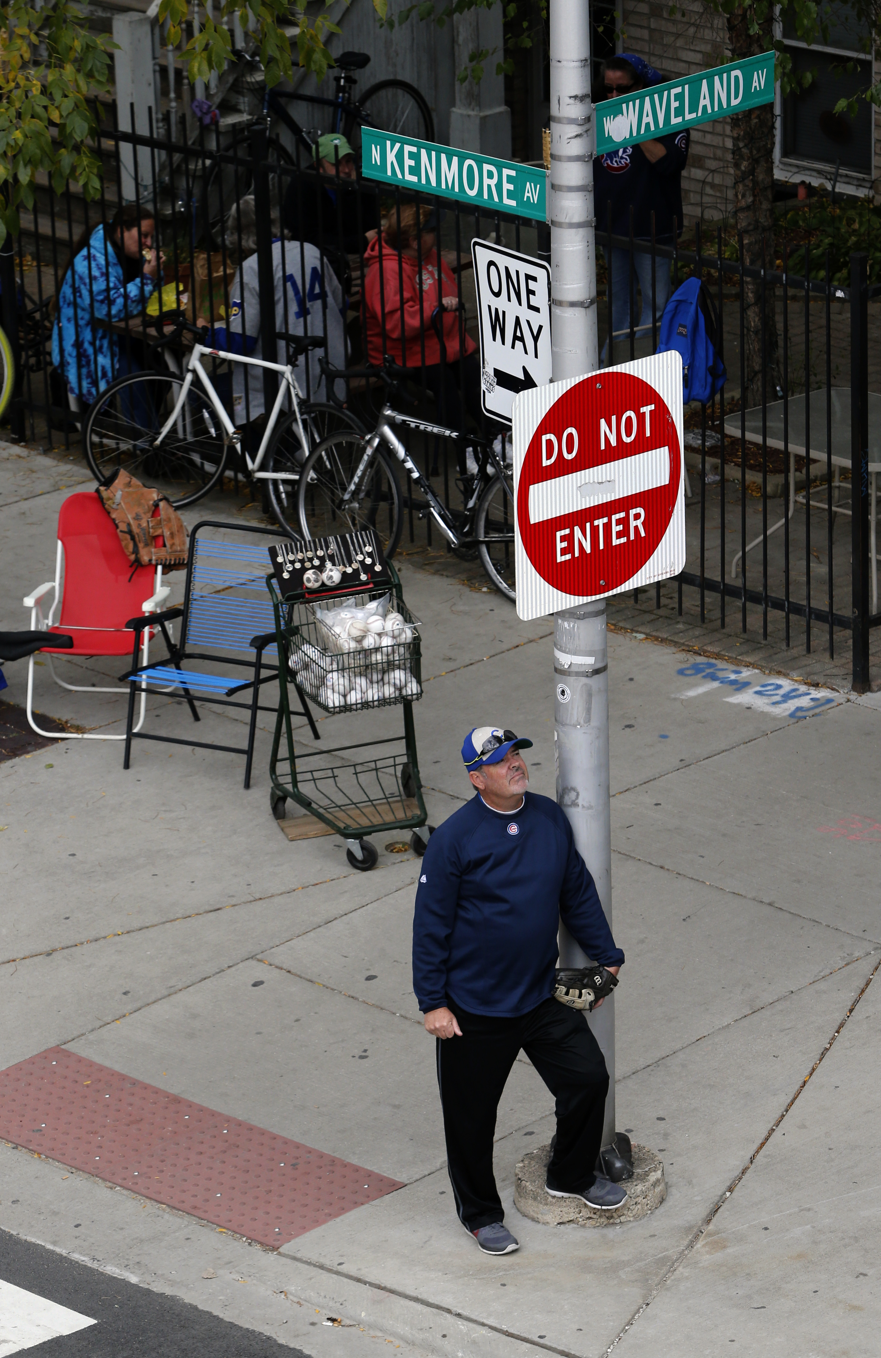 As one of many ballhawks position along Waveland Avenue across the street from Wrigley Field, Ross McKeon from San Francisco waits for a ball during batting practice before Game 4 in baseball's National League Division Series between the Chicago Cubs and