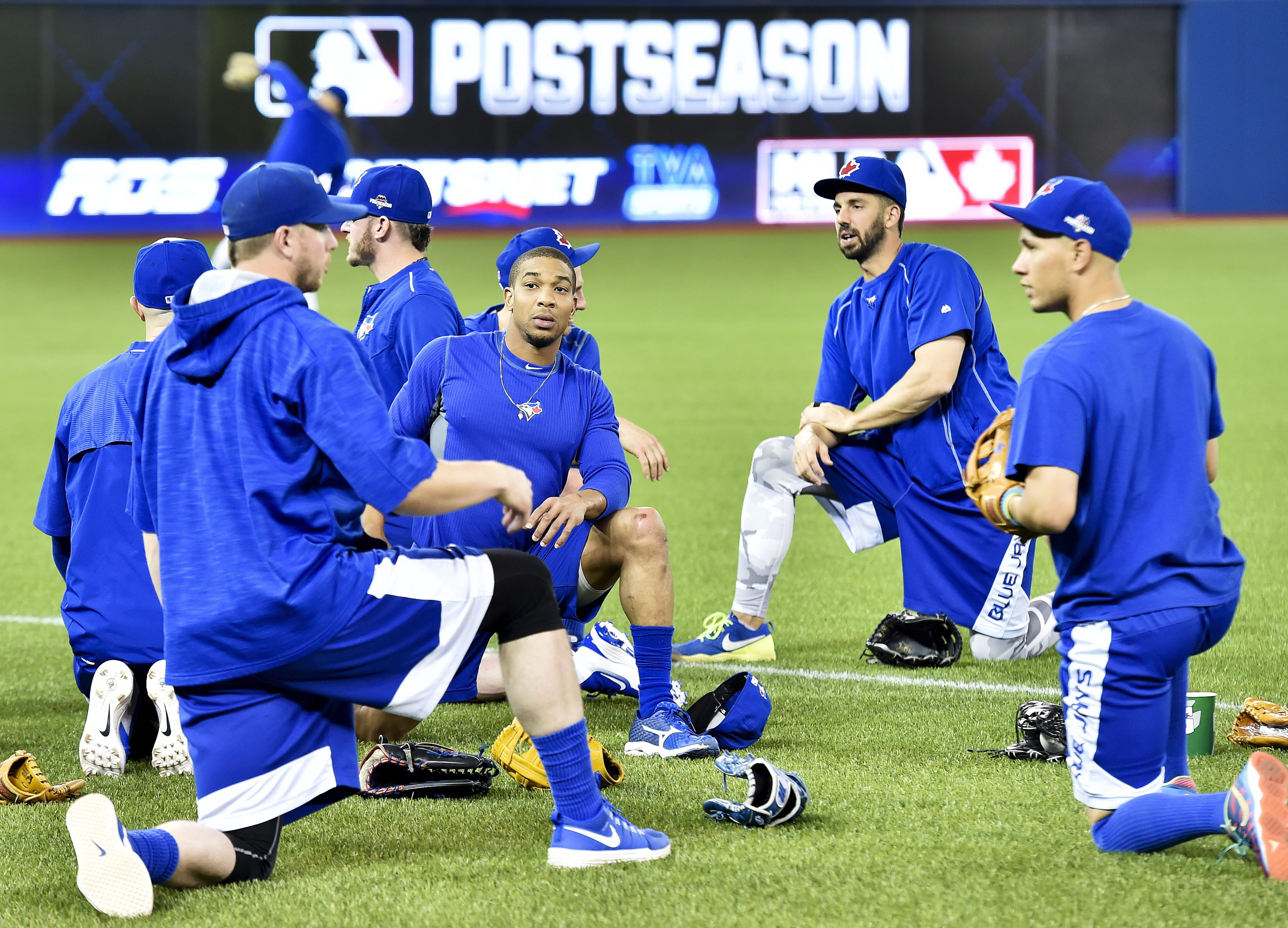 Toronto Blue Jays players stretch as they take part in an optional practice ahead of game five in the ALDS playoffs, Tuesday, Oct. 13, 2015 in Toronto. The Blue Jays host the Texas Rangers in Game 5 of the American League Division Series on Wednesday. The