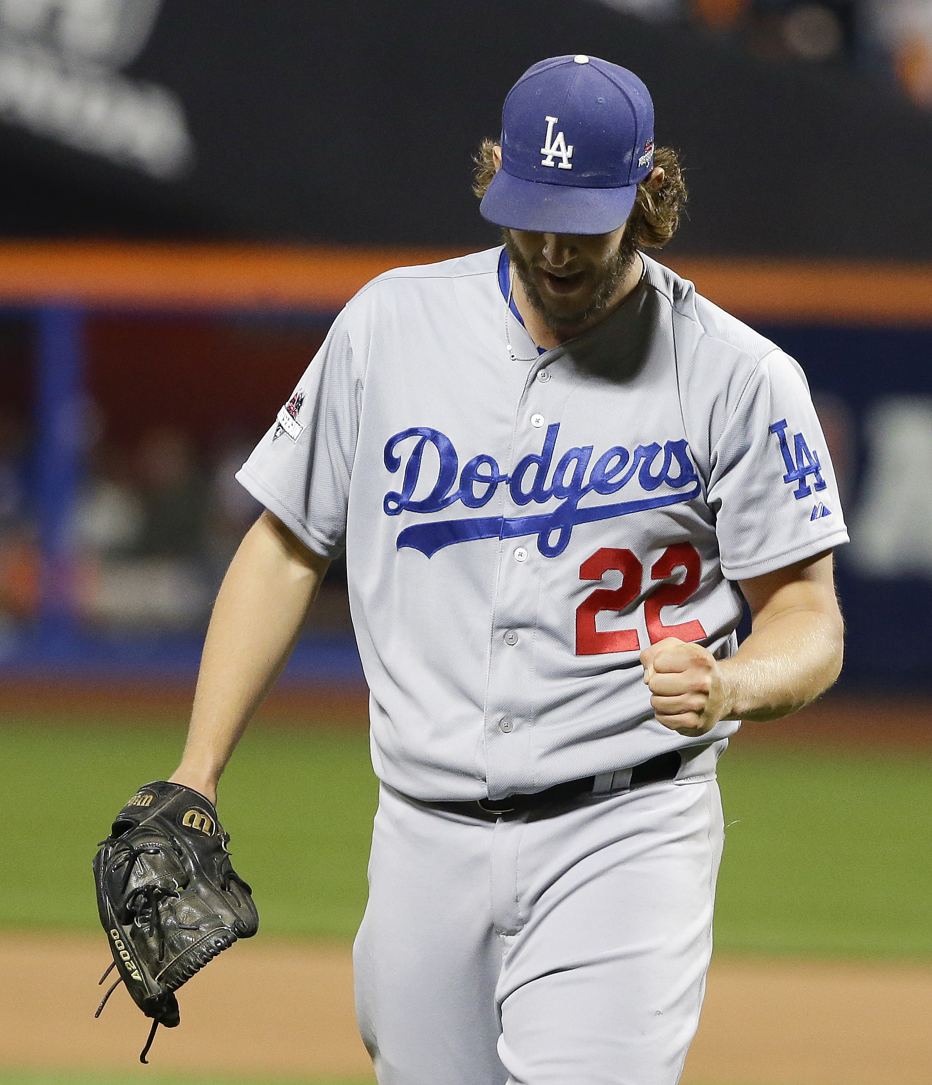 Los Angeles Dodgers pitcher Clayton Kershaw (22) pumps his fist as he walks off the field at the end of the seventh inning of baseball's Game 4 of the National League Division Series against the New York Mets, Tuesday, Oct. 13, 2015, in New York. (AP Phot