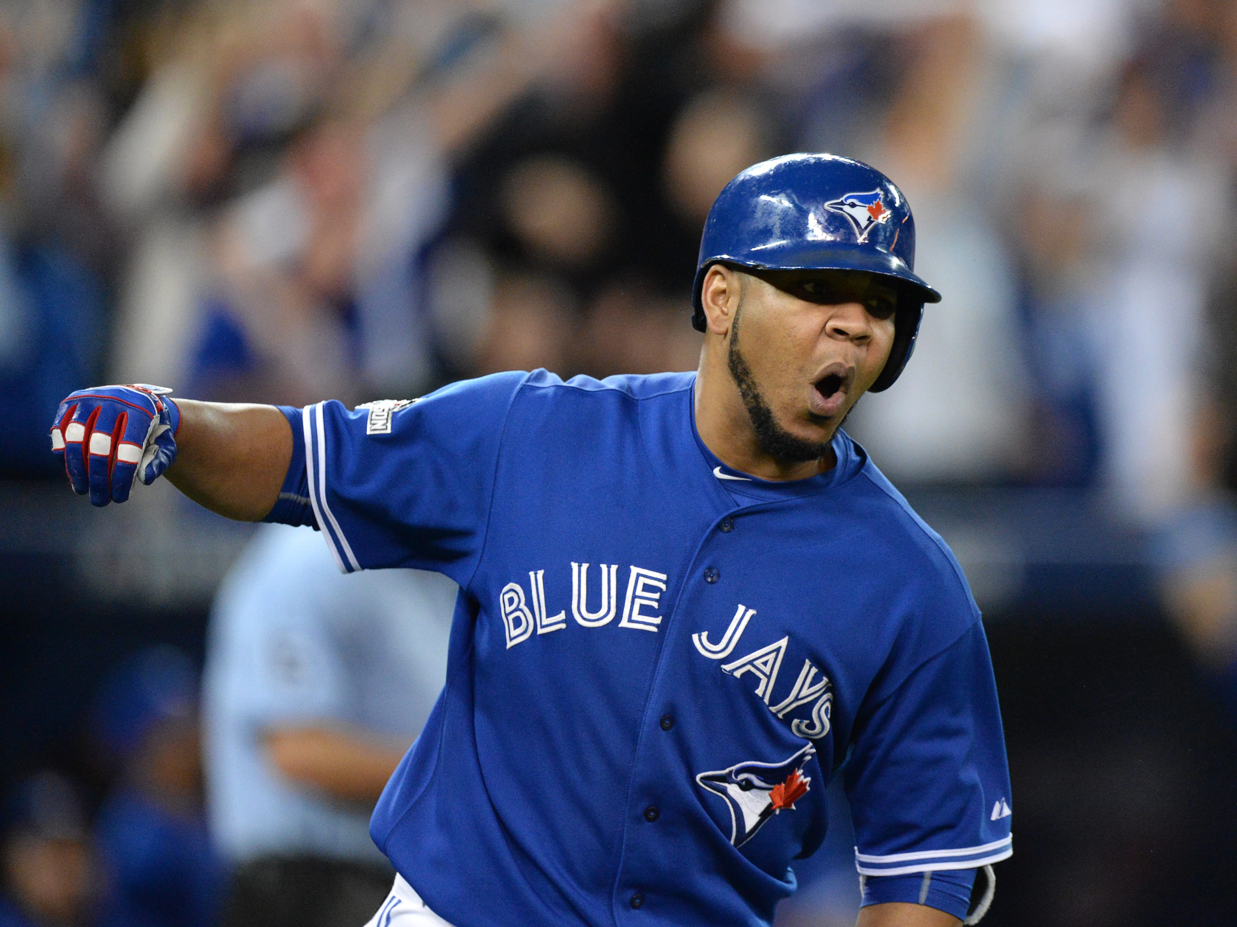 Toronto Blue Jays' Edwin Encarnacion rounds the bases on a solo home run during the sixth inning in Game 5 of baseball's American League Division Series against the Texas Rangers, Wednesday, Oct. 14, 2015 in Toronto. (Chris Young/The Canadian Press via AP
