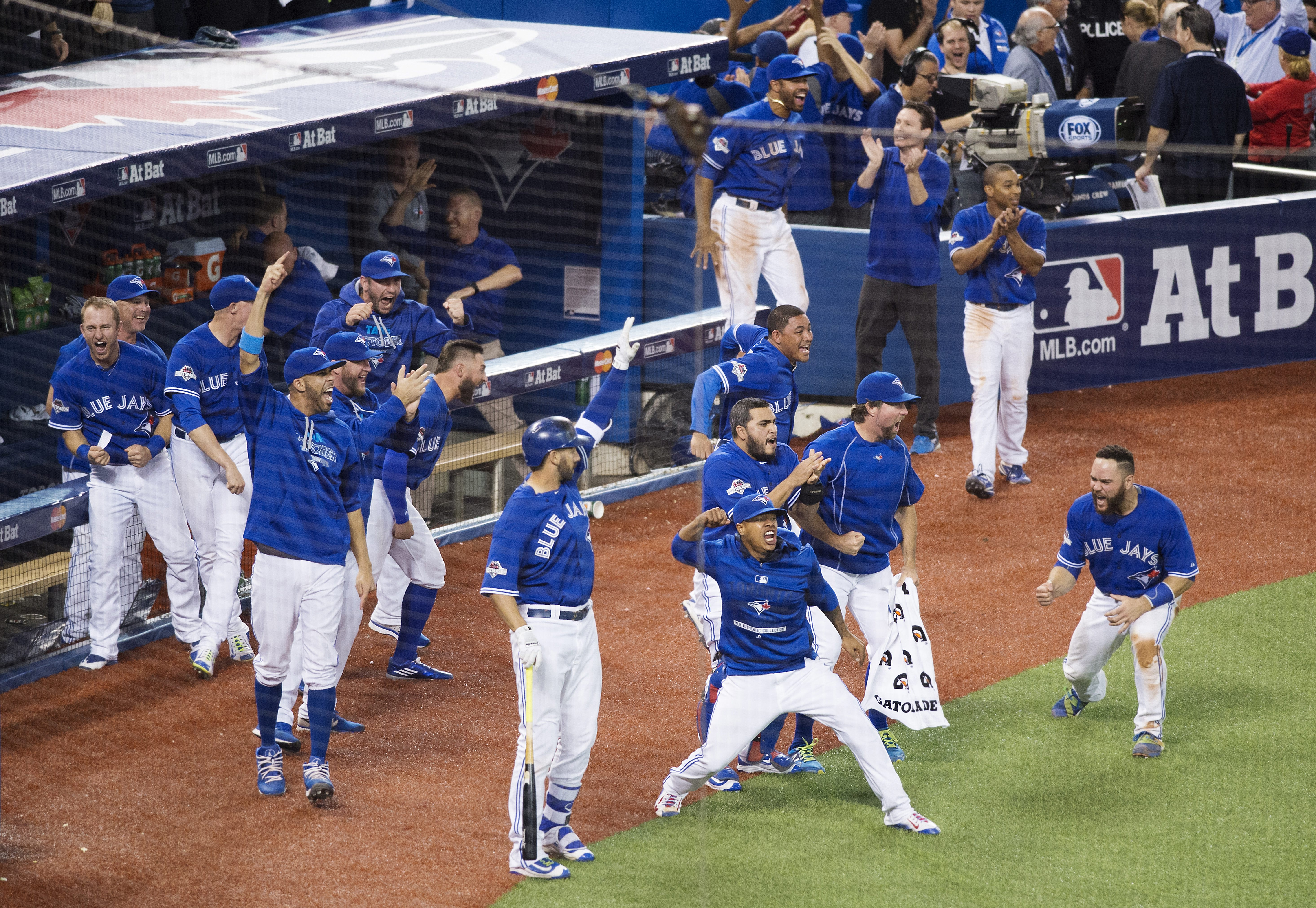 Members of the Toronto Blue Jays celebrate following a three-run home run by teammate Jose Bautista during the seventh inning in Game 5 of baseball's American League Division Series, Wednesday, Oct. 14, 2015 in Toronto. (Darren Calabrese/The Canadian Pres