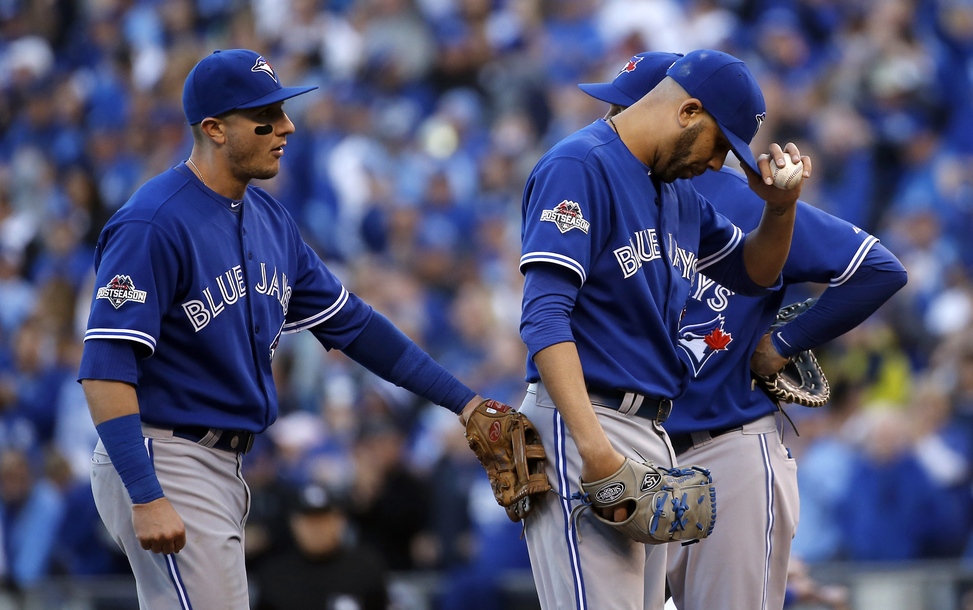 Toronto Blue Jays starting pitcher David Price, front right, reacts after being taken out during the seventh inning of Game 2 of baseball's American League Championship Series against the Kansas City Royals, Saturday, Oct. 17, 2015, in Kansas City, Mo. (A
