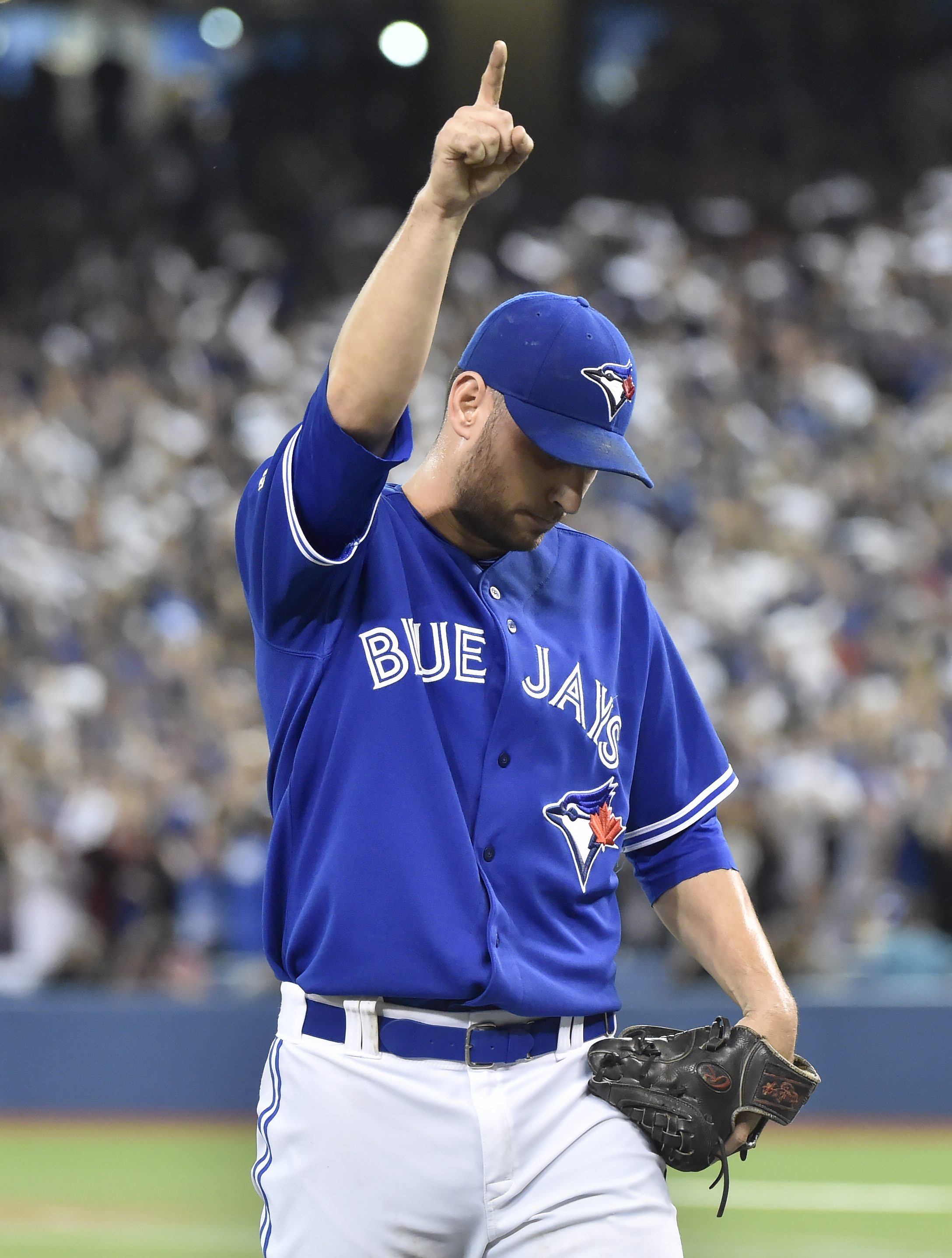 Toronto Blue Jays' starting pitcher Marco Estrada signals number one after being pulled from the game against the Kansas City Royals during the eighth inning in Game 5 of baseball's American League Championship Series on Wednesday, Oct. 21, 2015, in Toron