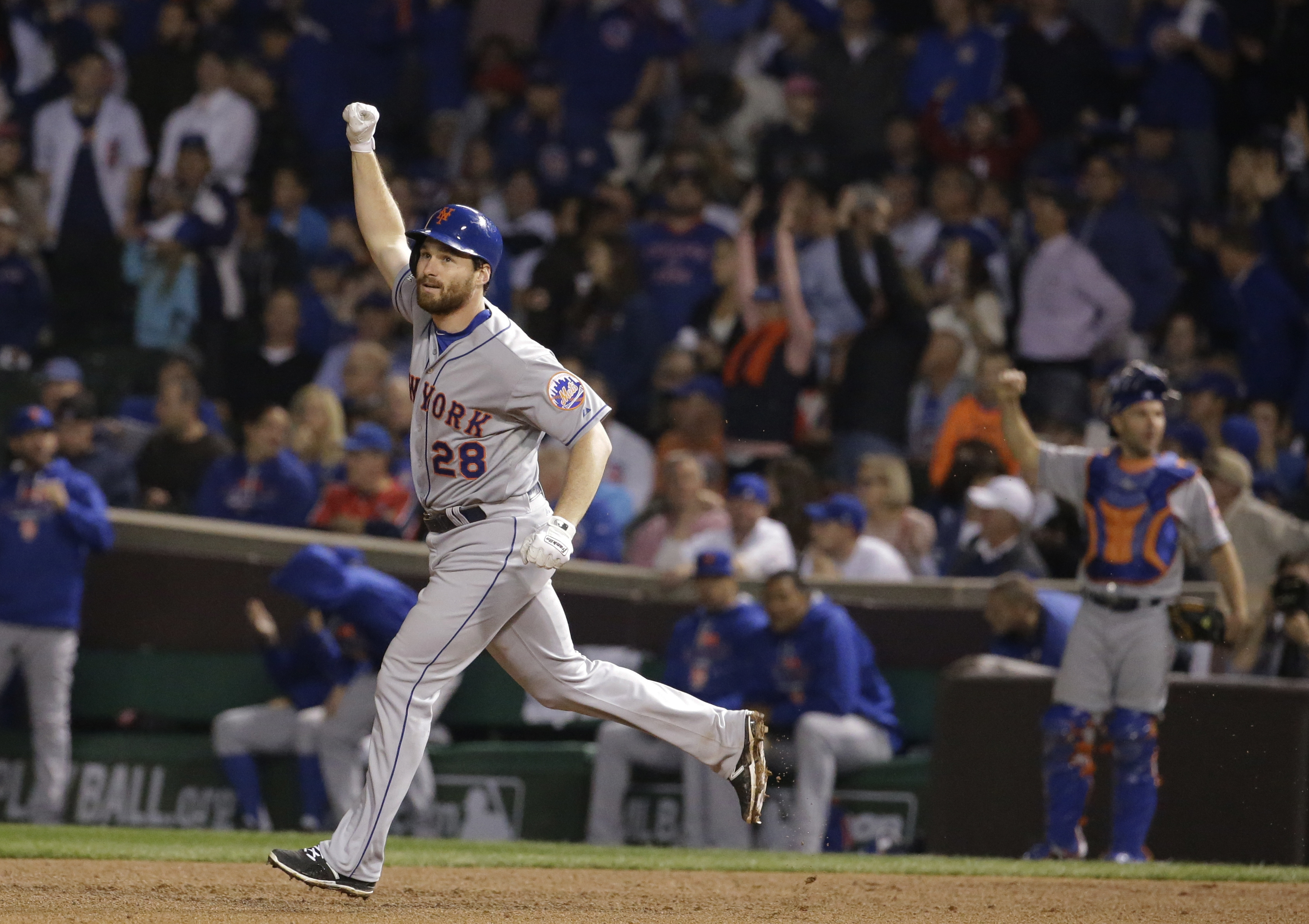 New York Mets' Daniel Murphy celebrates after hitting a two-run home run during the eighth inning of Game 4 of the National League baseball championship series against the Chicago Cubs Wednesday, Oct. 21, 2015, in Chicago. (AP Photo/Nam Y. Huh)