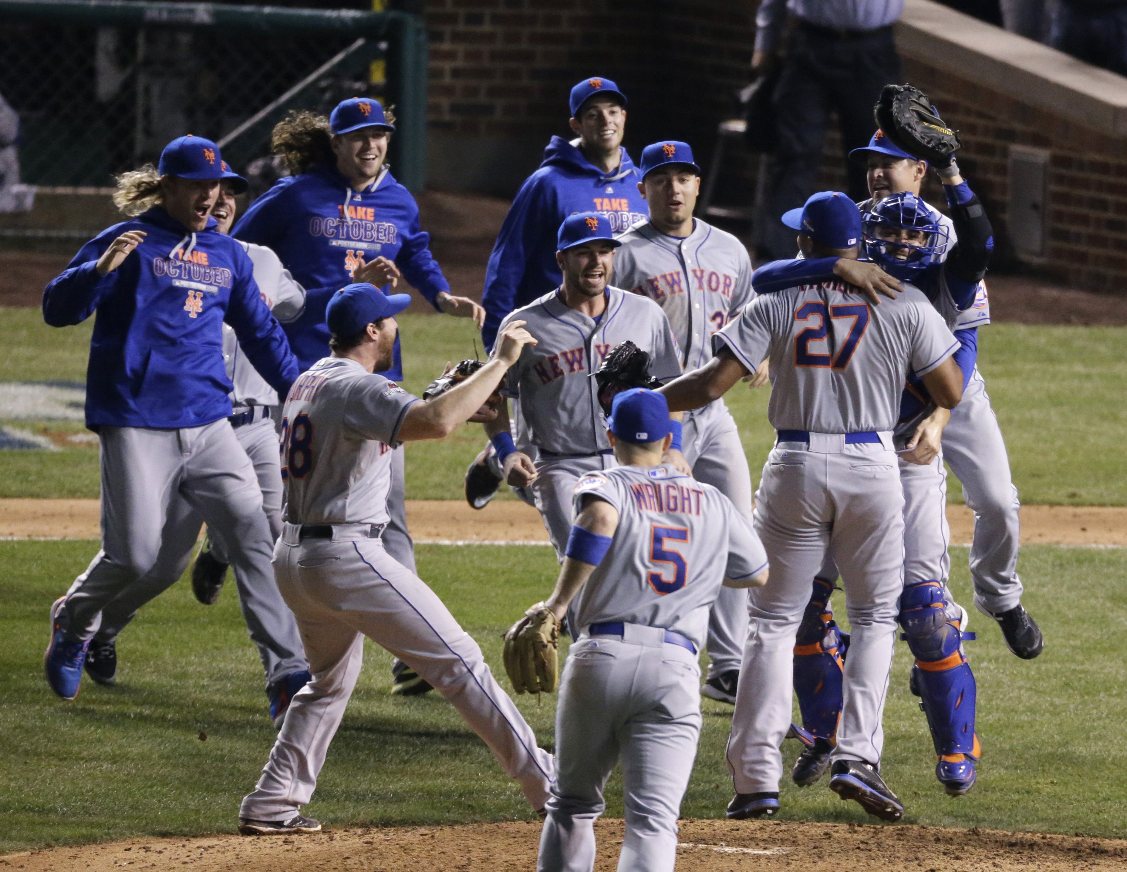 The New York Mets celebrate after Game 4 of the National League baseball championship series against the Chicago Cubs Wednesday, Oct. 21, 2015, in Chicago. The Mets won 8-3 to advance to the World Series. (AP Photo/David Goldman)