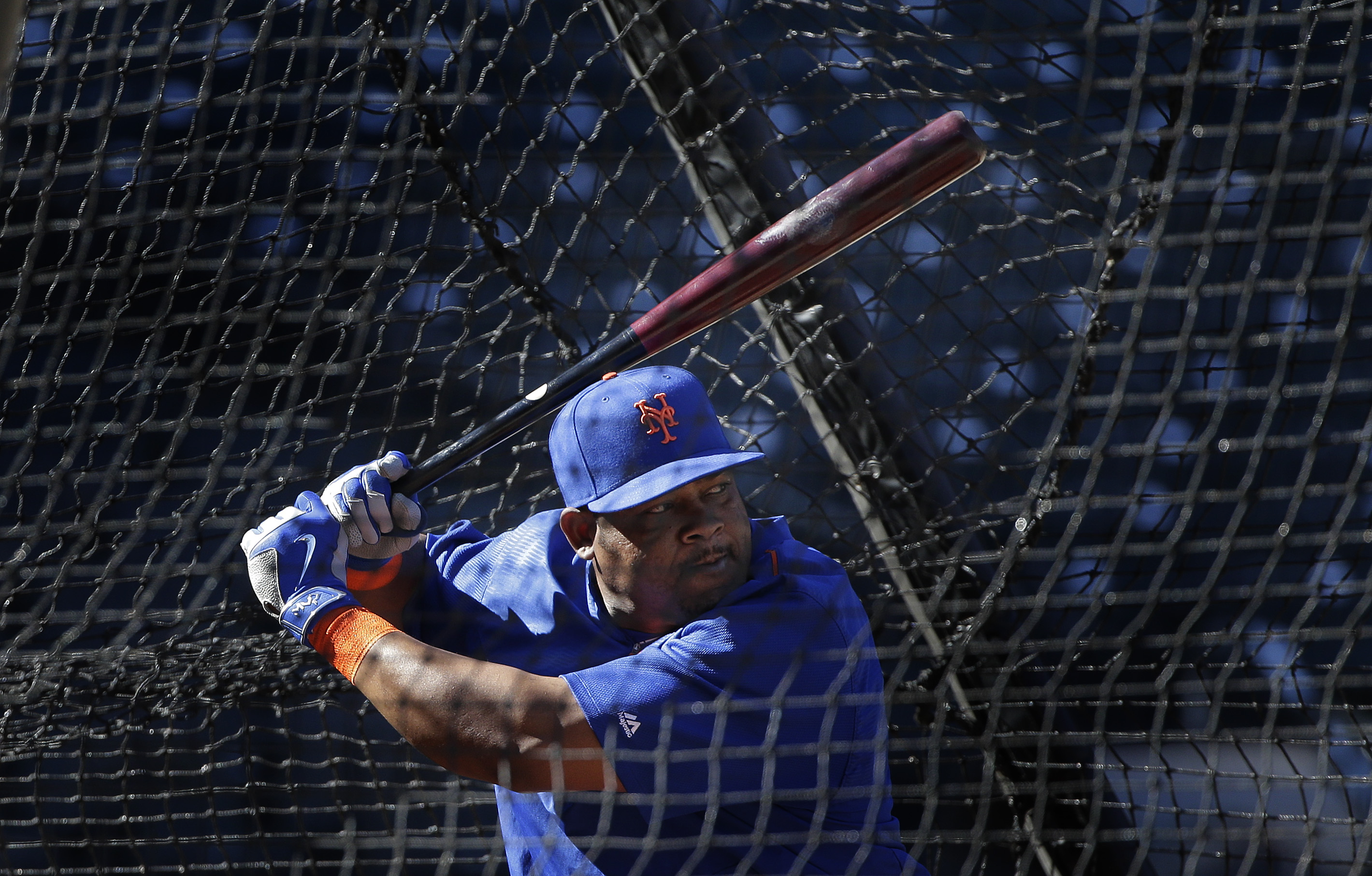 New York Mets' Juan Uribe takes batting practice during a voluntary team workout, Friday, Oct. 23, 2015, in New York. After sweeping the Chicago Cubs to win the NLCS, the Mets will play in the World Series against the winner of the ALCS. (AP Photo/Julie J