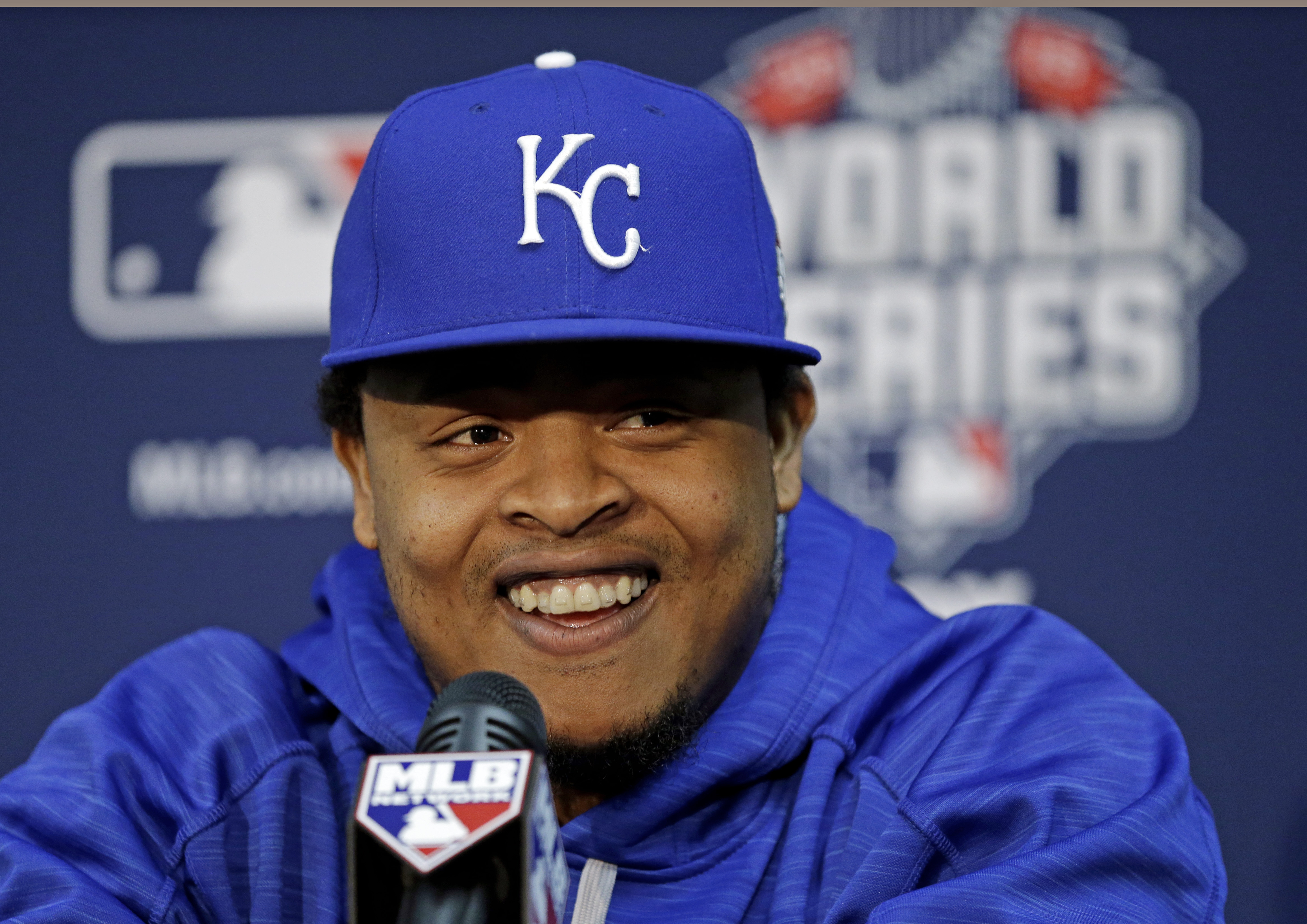 Kansas City Royals starting pitcher Edinson Volquez talks during media day for the Major League Baseball World Series against the New York Mets Monday, Oct. 26, 2015, in Kansas City, Mo. (AP Photo/David J. Phillip)