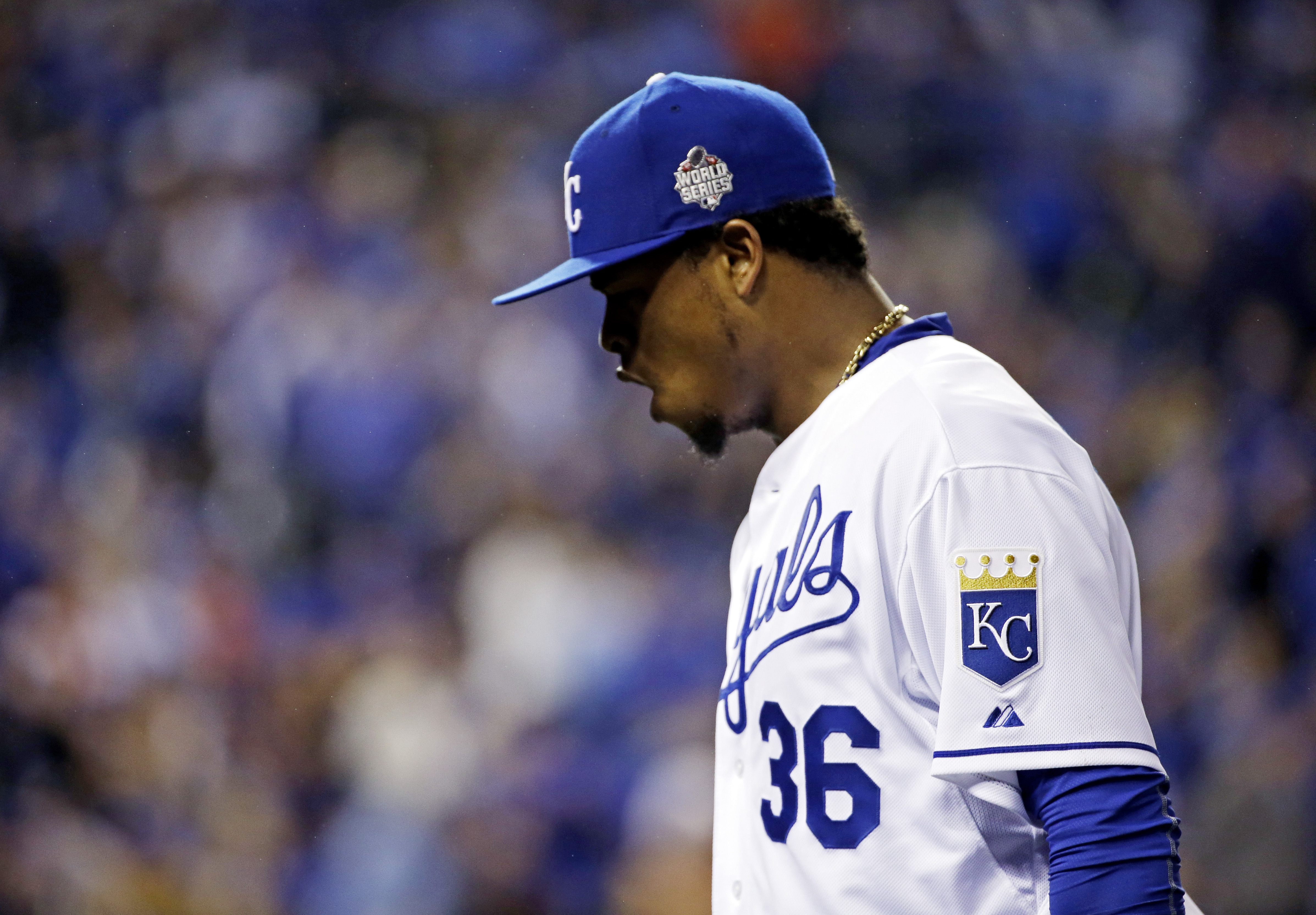 Kansas City Royals pitcher Edinson Volquez reacts during the fifth inning of Game 1 of the Major League Baseball World Series against the New York Mets Tuesday, Oct. 27, 2015, in Kansas City, Mo. New York Mets' Curtis Granderson hit a home run in the inni