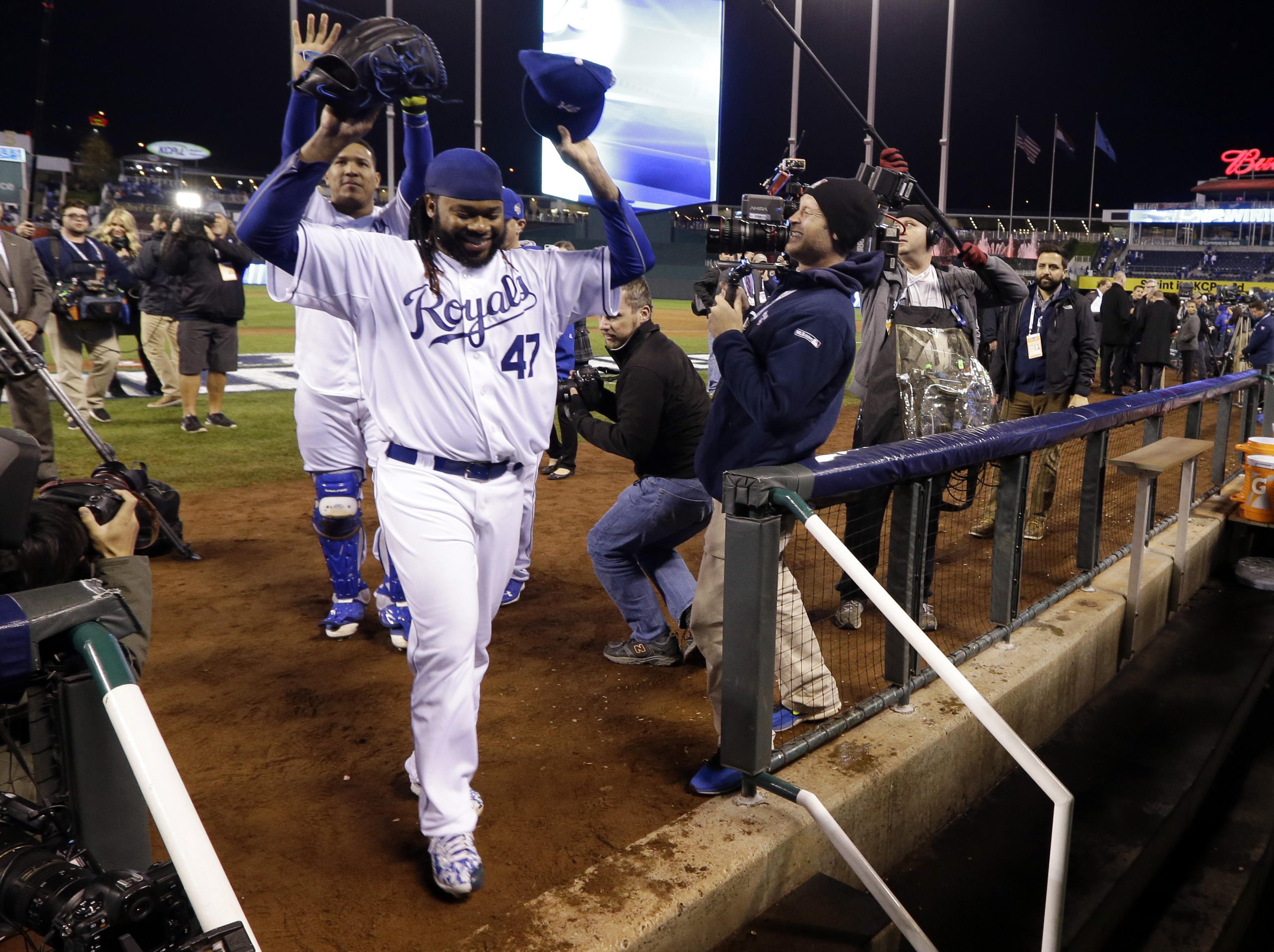 Kansas City Royals pitcher Johnny Cueto celebrates after Game 2 of the Major League Baseball World Series against the New York Mets Wednesday, Oct. 28, 2015, in Kansas City, Mo. The Royals won 7-1 to take a 2-0 lead in the series. (AP Photo/David J. Phill