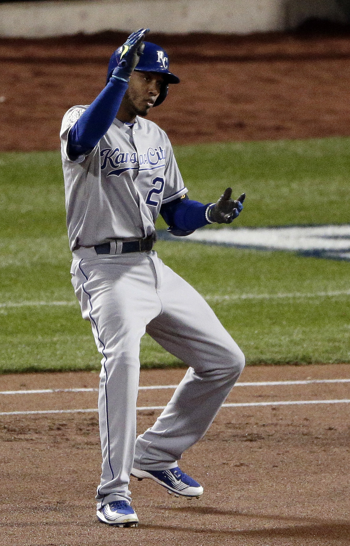 Kansas City Royals' Alcides Escobar celebrates his single against the New York Mets during the first inning of Game 4 of the Major League Baseball World Series Saturday, Oct. 31, 2015, in New York. (AP Photo/Charlie Riedel)