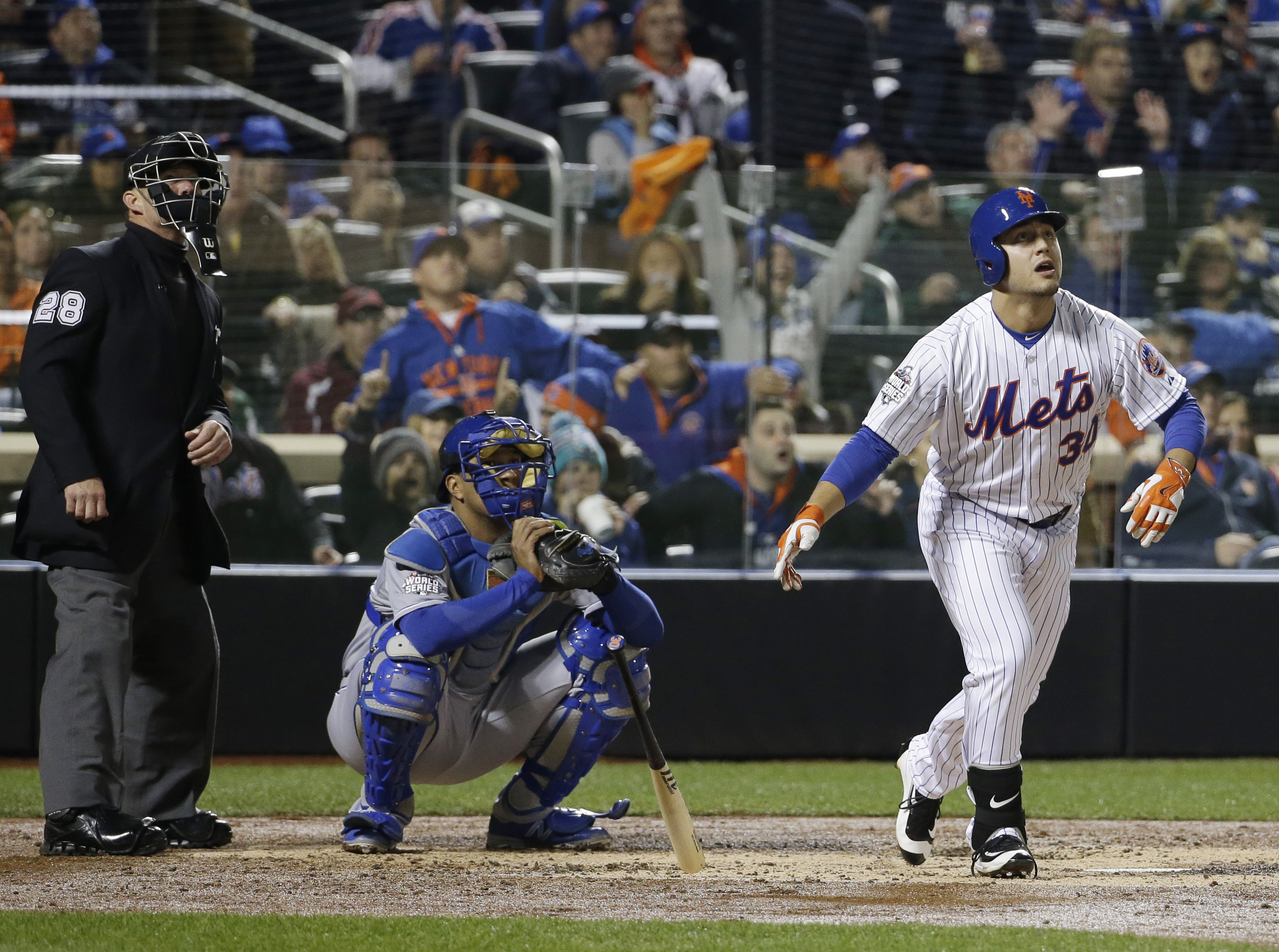 New York Mets' Michael Conforto hits a home run during the third inning of Game 4 of the Major League Baseball World Series against the Kansas City Royals Saturday, Oct. 31, 2015, in New York. (AP Photo/David J. Phillip)