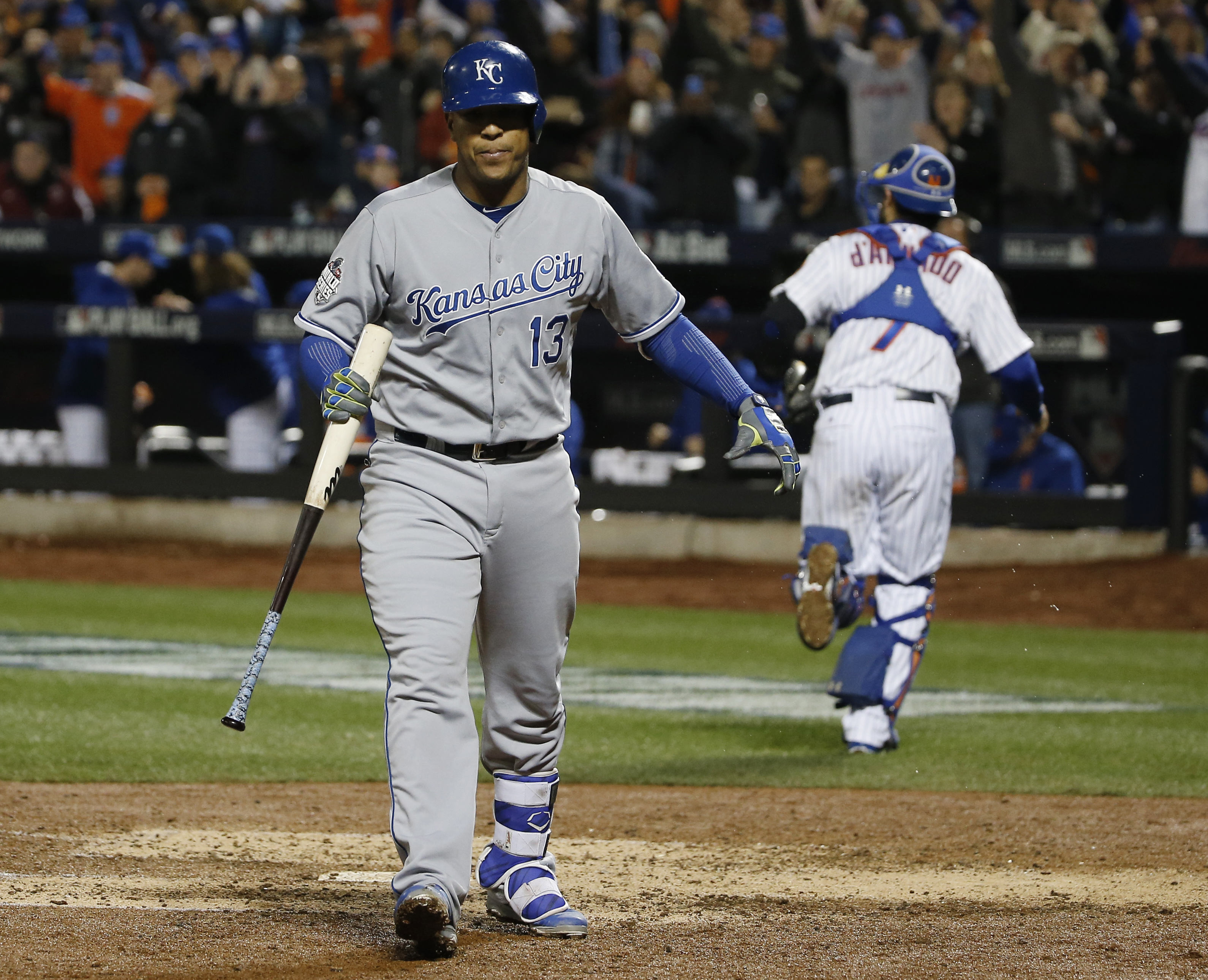 Kansas City Royals' Salvador Perez walks back to the dugout after striking out during the sixth inning of Game 4 of the Major League Baseball World Series Saturday, Oct. 31, 2015, in New York. (AP Photo/Matt Slocum)