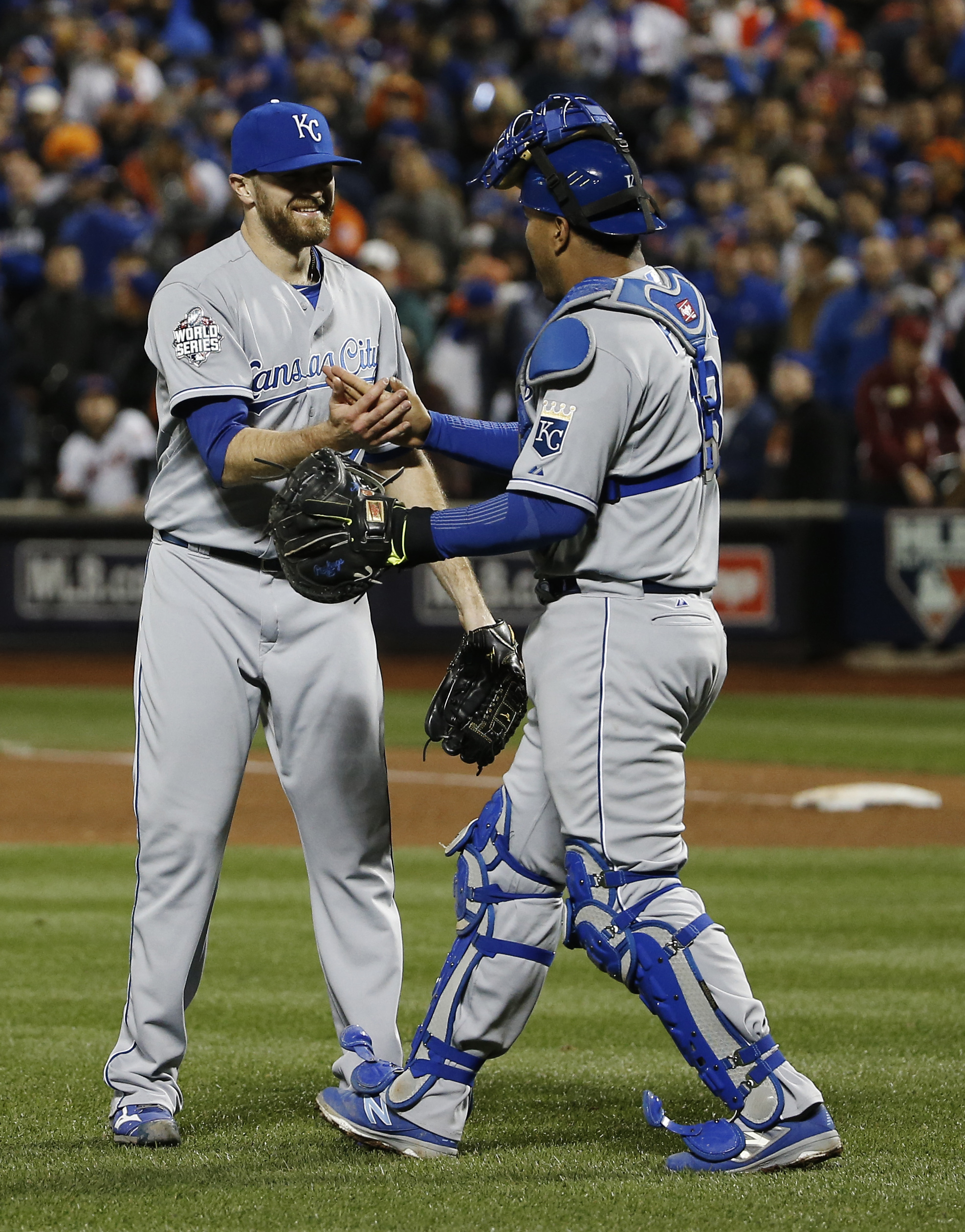 Kansas City Royals pitcher Wade Davis is congratulated by catcher Salvador Perez after winning Game 4 of the Major League Baseball World Series Saturday, Oct. 31, 2015, in New York. The Royals won 5-3 to take a 3-0 lead in the series. (AP Photo/Matt Slocu