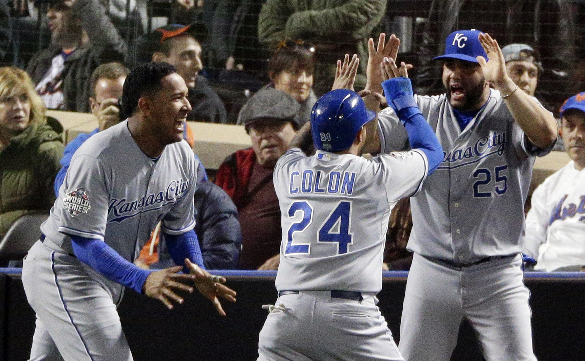 Kansas City Royals' Christian Colon celebrates after scoring against the New York Mets during the 12th inning of Game 5 of the Major League Baseball World Series Monday, Nov. 2, 2015, in New York. (AP Photo/Charlie Riedel)