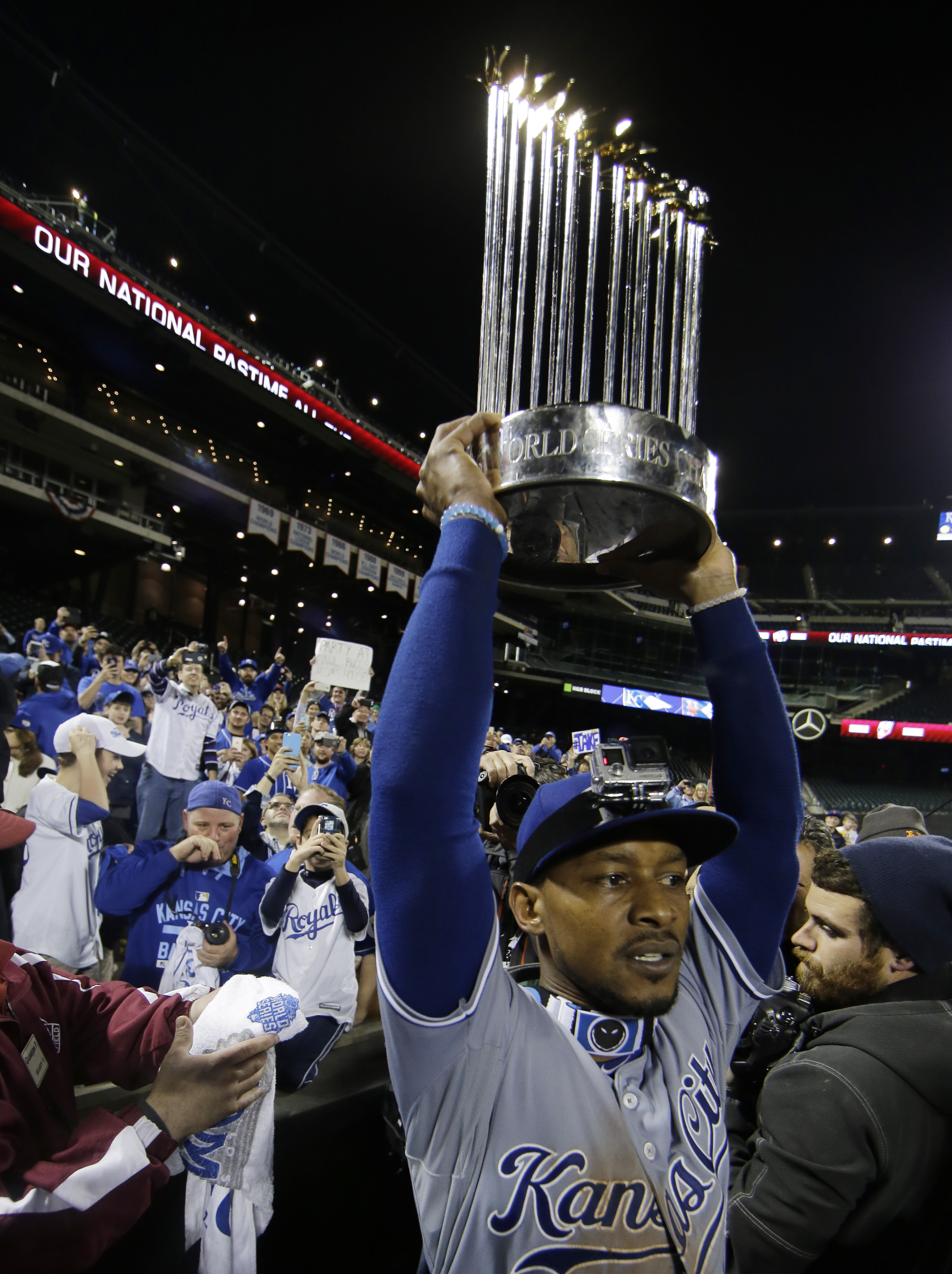 Kansas City Royals' Jarrod Dyson holds the World Series trophy after Game 5 of the Major League Baseball World Series against the New York Mets Monday, Nov. 2, 2015, in New York. The Royals won 7-2 to win the series. (AP Photo/Matt Slocum)