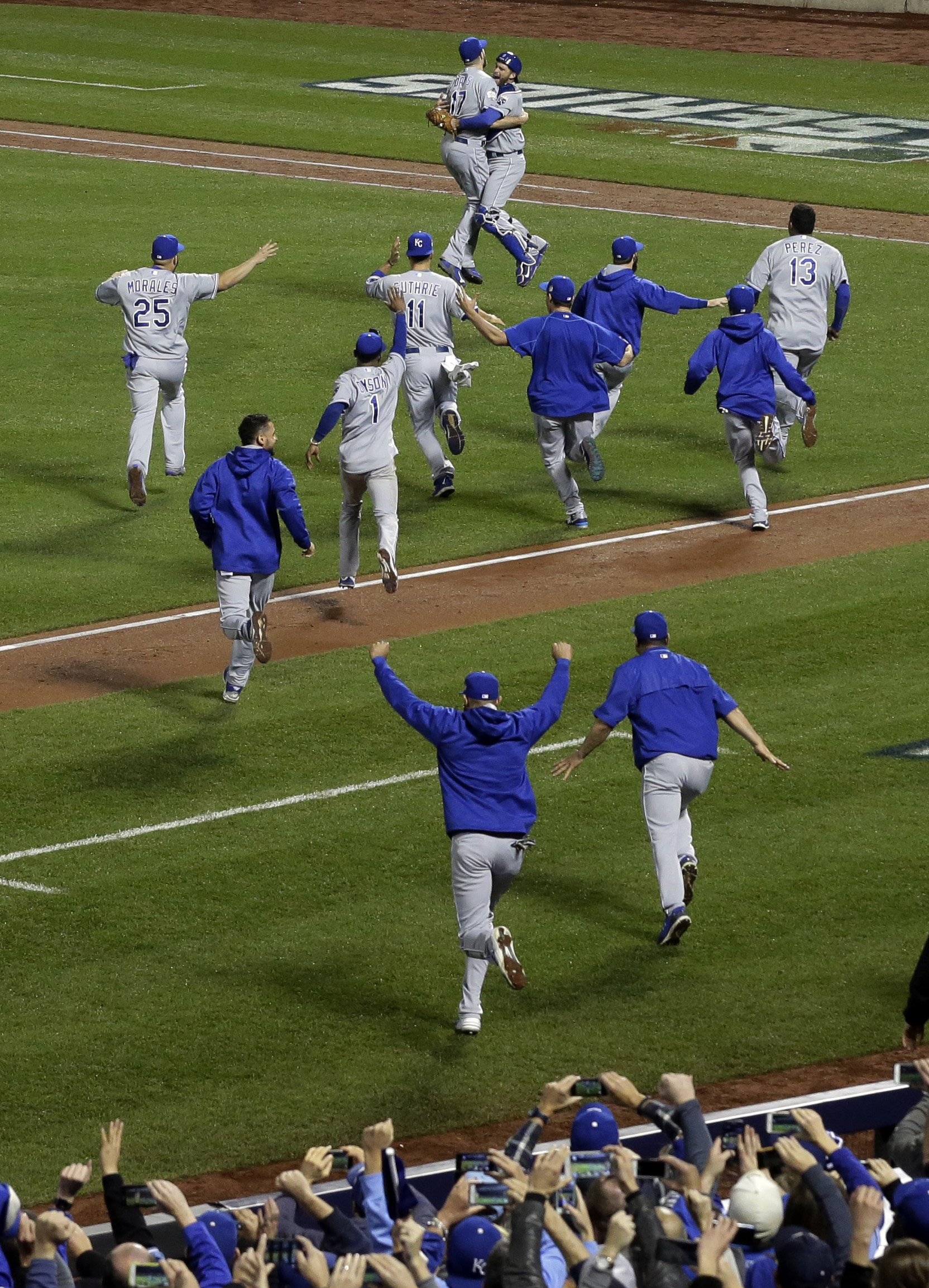 Member of the Kansas City Royals celebrates after Game 5 of the Major League Baseball World Series against the New York Mets Monday, Nov. 2, 2015, in New York. The Royals won 7-2 to win the series. (AP Photo/Julie Jacobson)