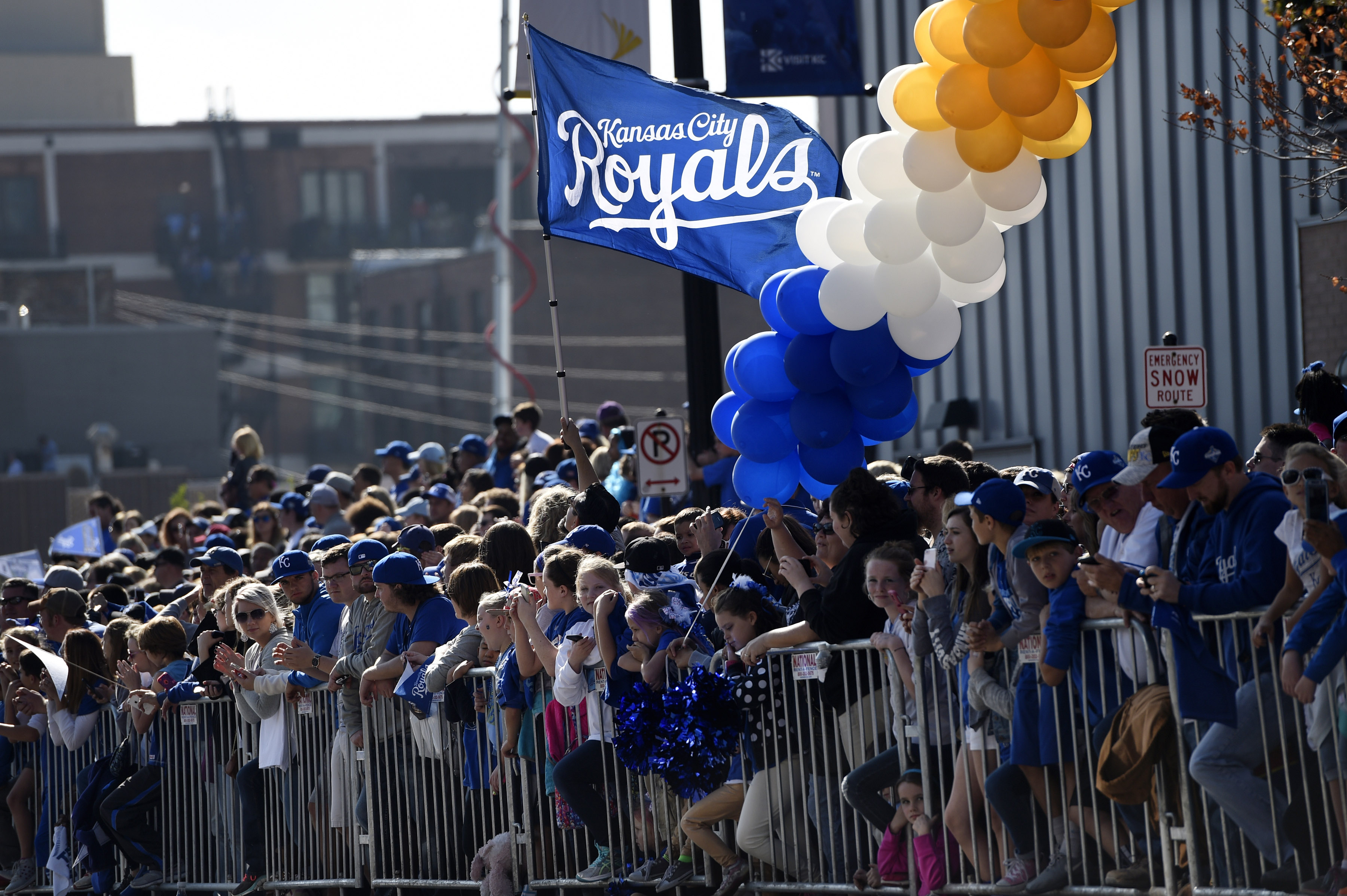Fans line a street waiting for the parade for the Kansas City Royals, honoring the teams first baseball World Series trophy in 30 years, Tuesday, Nov. 3, 2015 in Kansas City.  (Shane Keyser /The Kansas City Star via AP) MANDATORY CREDIT
