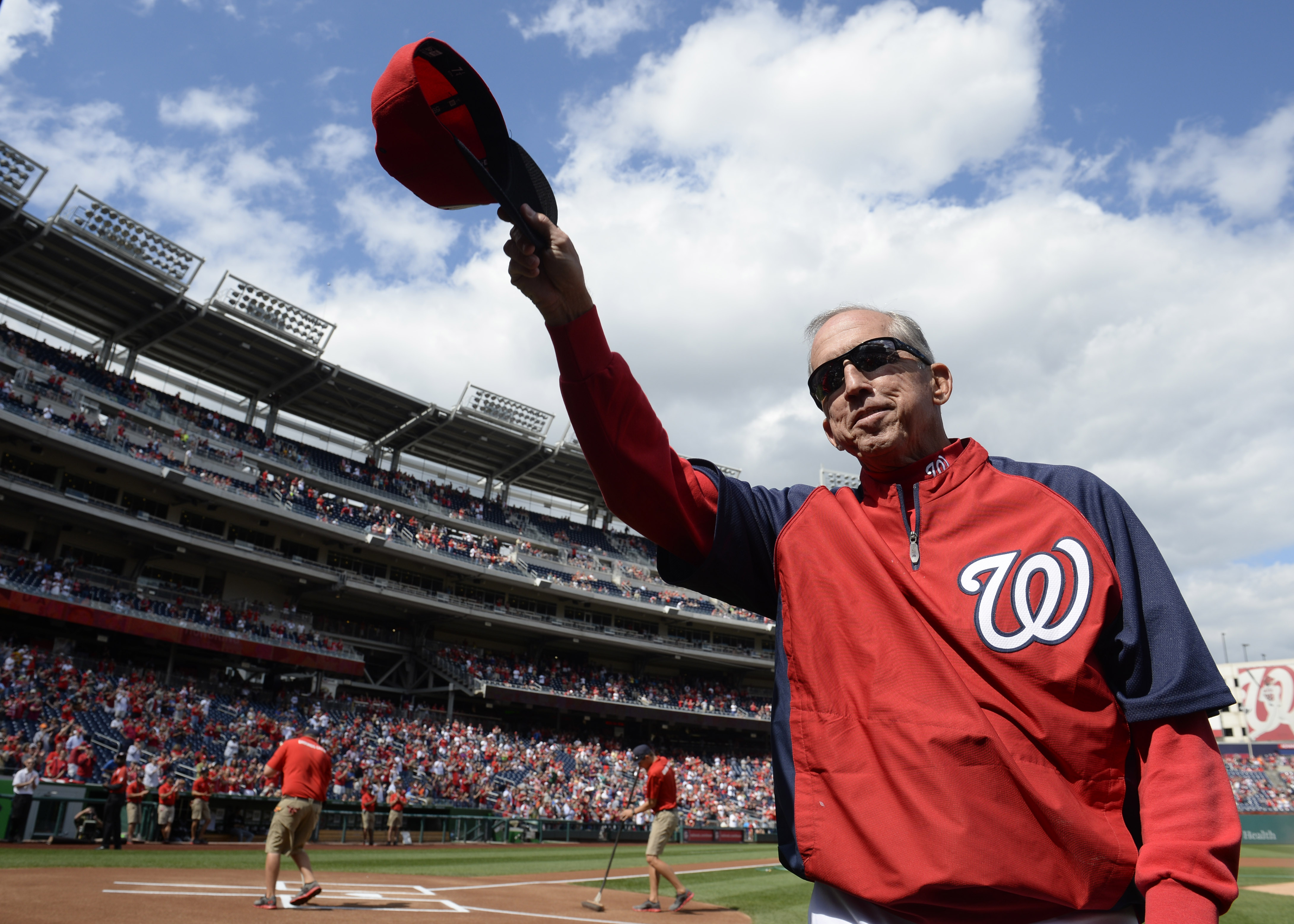 FILE - Im this Sept. 22, 2013, file photo, Washington National manager Davey Johnson tips his cap to the crowd before a baseball game against the Miami Marlins at Nationals Park in Washington. A former All-Star infielder who had already managed three team