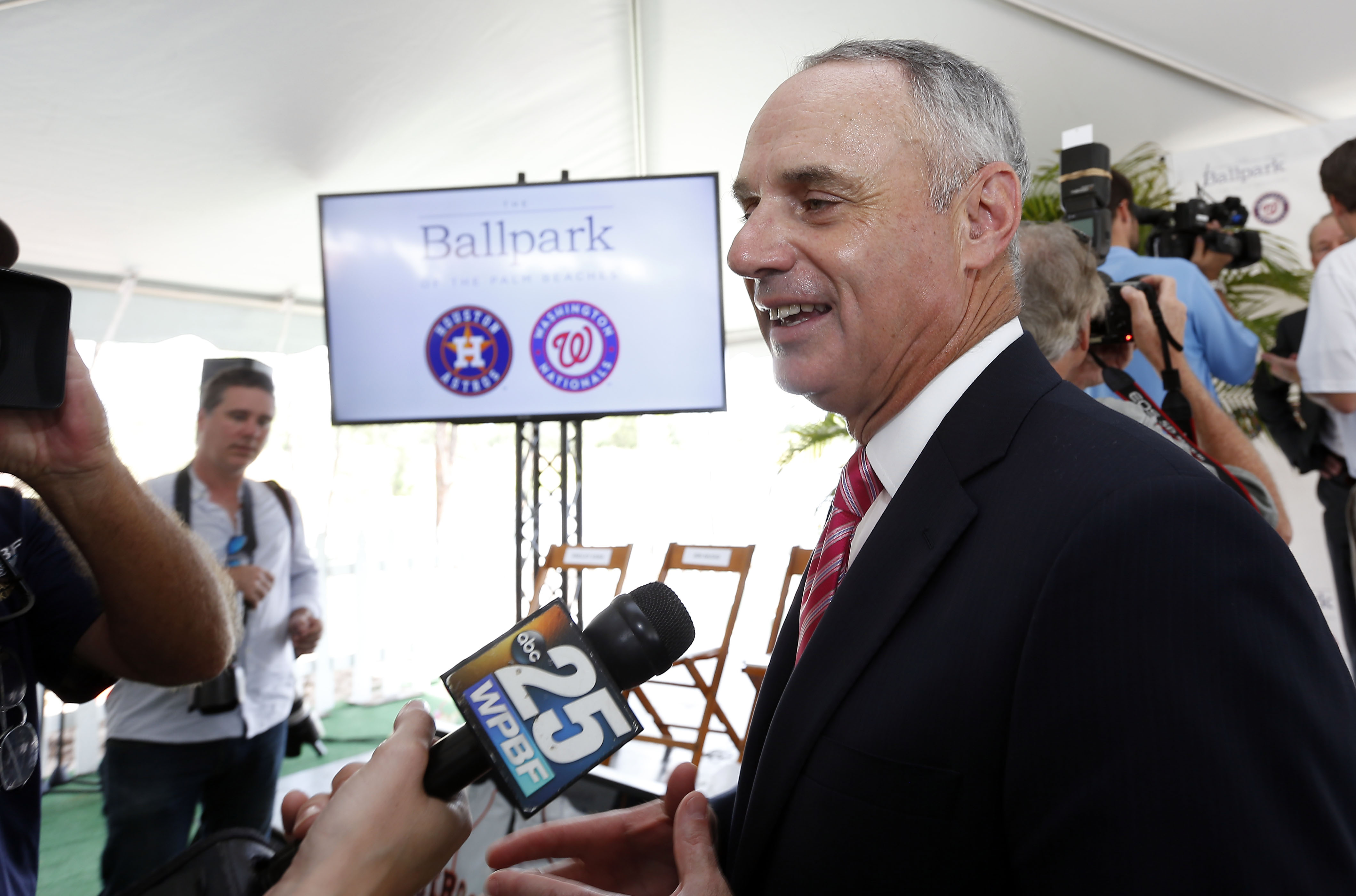 Major League Baseball commissioner Rob Manfred speaks with reporters after the groundbreaking ceremony for the future home of the of Houston Astros and the Washington Nationals spring training facility on Monday, Nov. 9, 2015, in West Palm Beach, Fla. (AP
