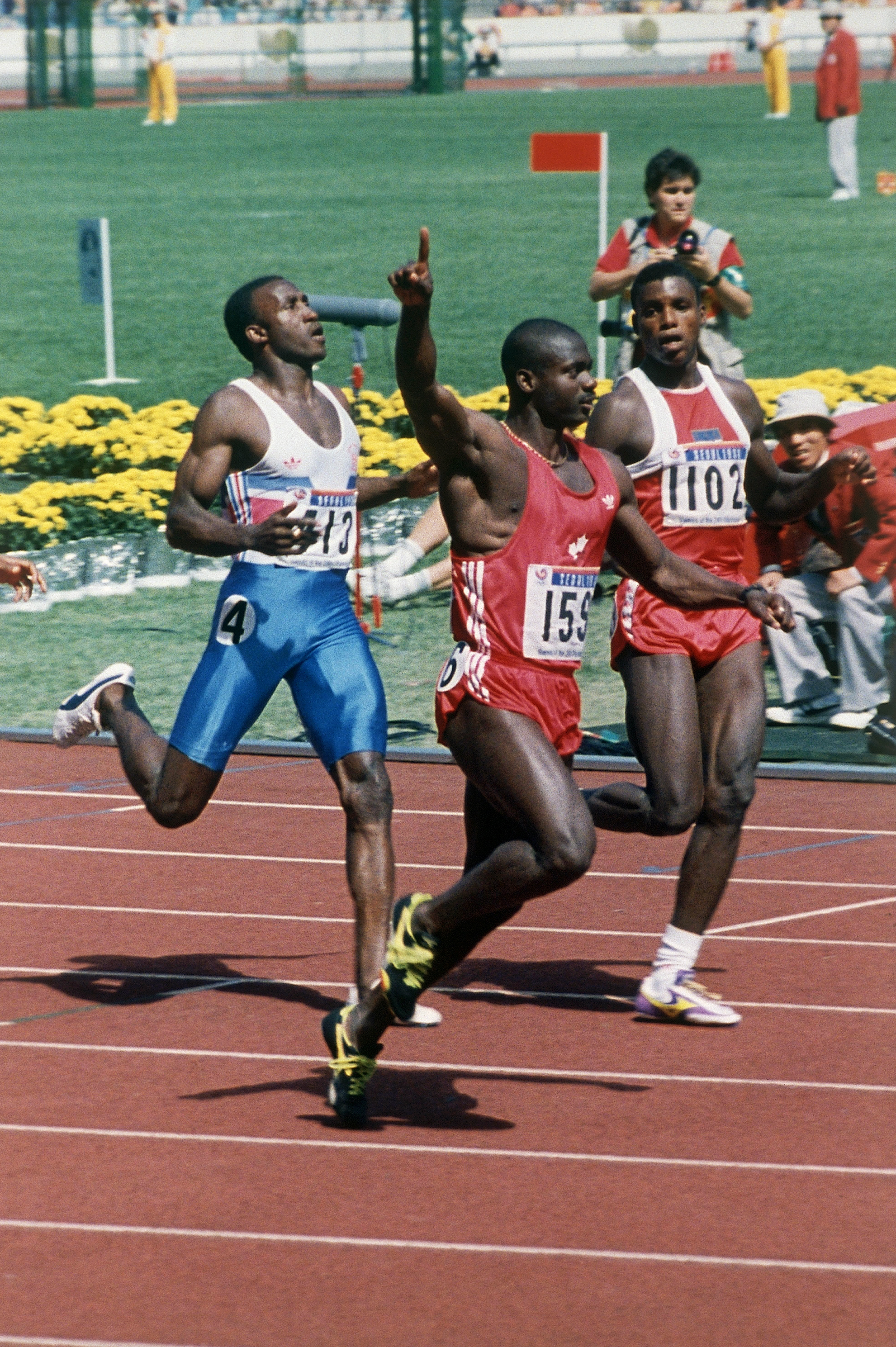FILE - In this Sept. 24, 1988 file photo Ben Johnson of Canada gestures after winning the 100-meter dash beating Carl Lewis of the United States, behind at right at the Olympics in Seoul. The International Olympic Committee withdrew Johnson's gold medal f