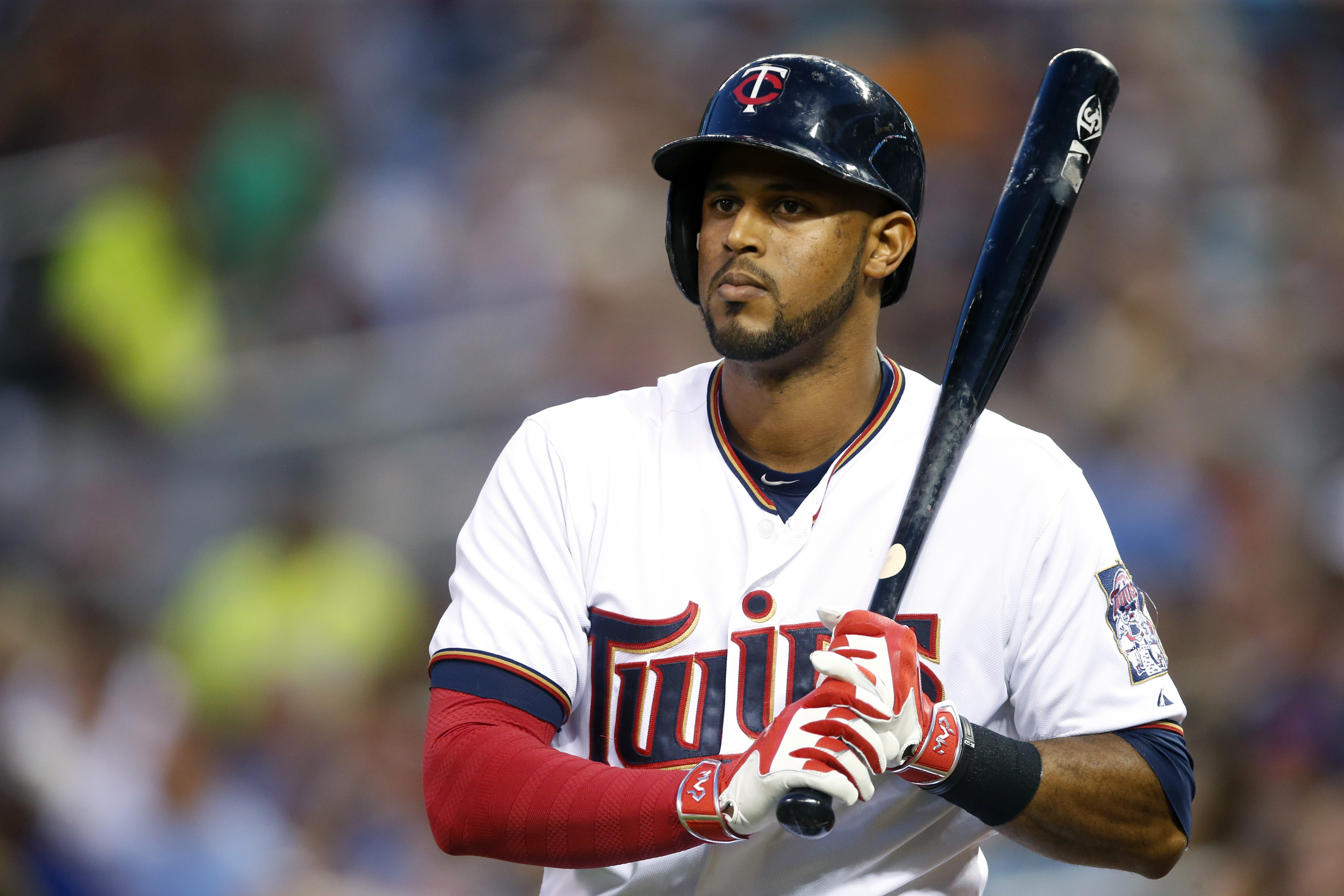 FILE - In this Sept. 15, 2015, file photo, Minnesota Twins' Aaron Hicks is on deck in a baseball game against the Detroit Tigers, in Minneapolis. New York Yankees general manager Brian Cashman is following through on his vow to start transforming the team