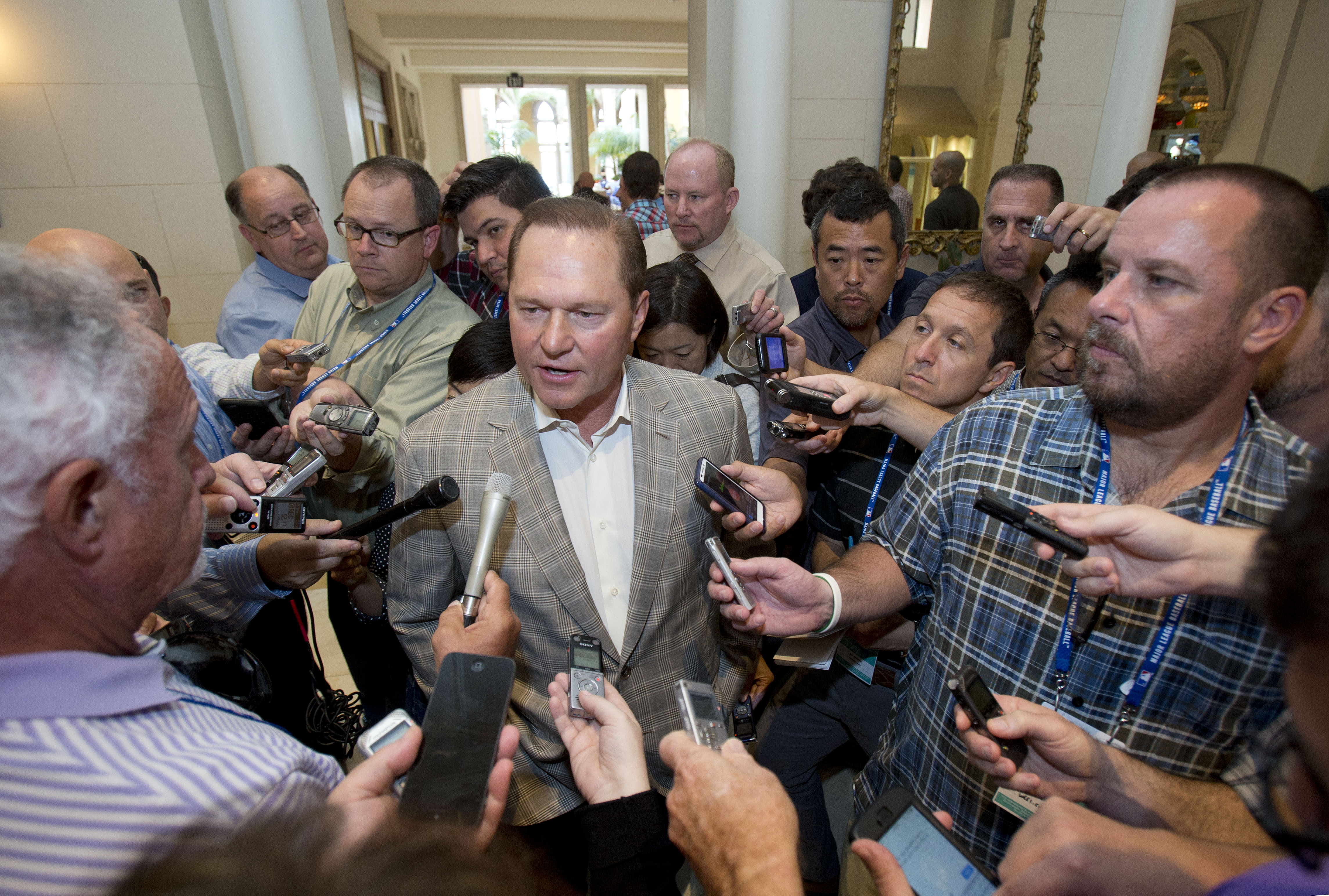 Sports agent Scott Boras, center, speaks to reporters at the baseball general managers' meetings, Wednesday, Nov. 11, 2015, in Boca Raton, Fla. (AP Photo/Wilfredo Lee)