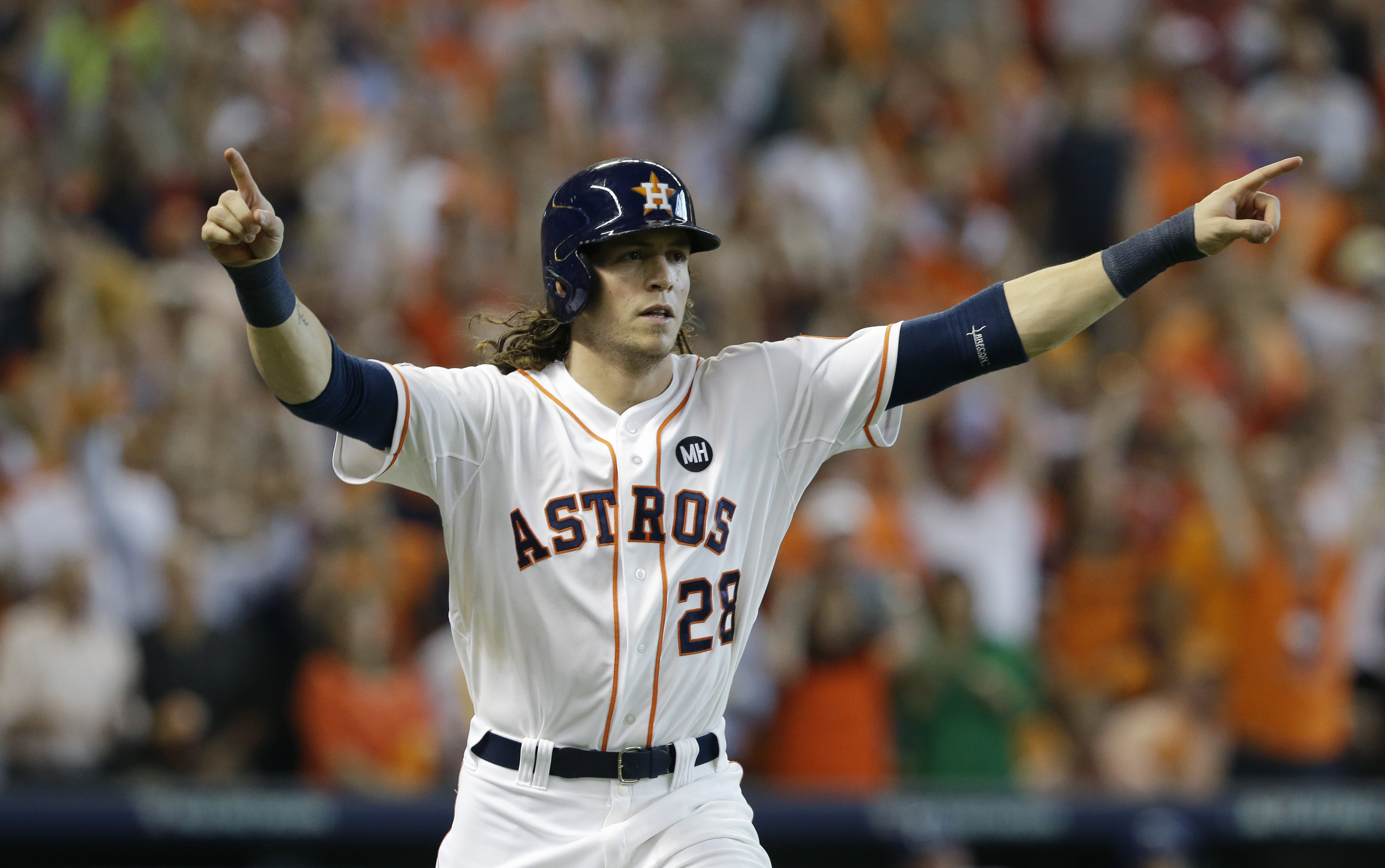 Houston Astros' Colby Rasmus (28) celebrates after hitting a solo home run against the Kansas City Royals in the seventh inning during Game 4 of baseball's American League Division Series, Monday, Oct. 12, 2015, in Houston. (AP Photo/Pat Sullivan)