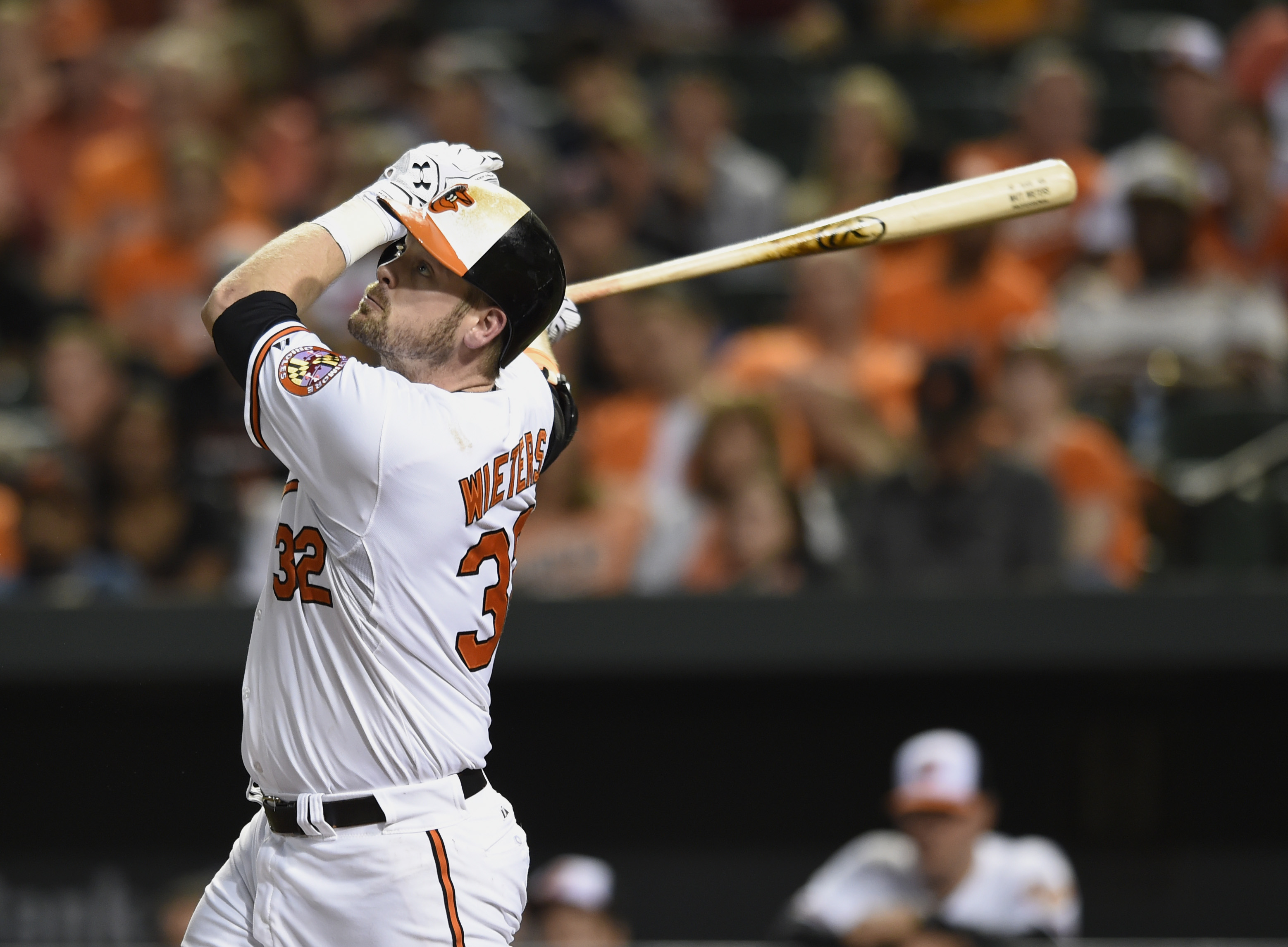 Baltimore Orioles' Matt Wieters follows through on a single against the Toronto Blue Jays in the fourth inning of a baseball game, Monday, Sept. 28, 2015, in Baltimore. (AP Photo/Gail Burton)
