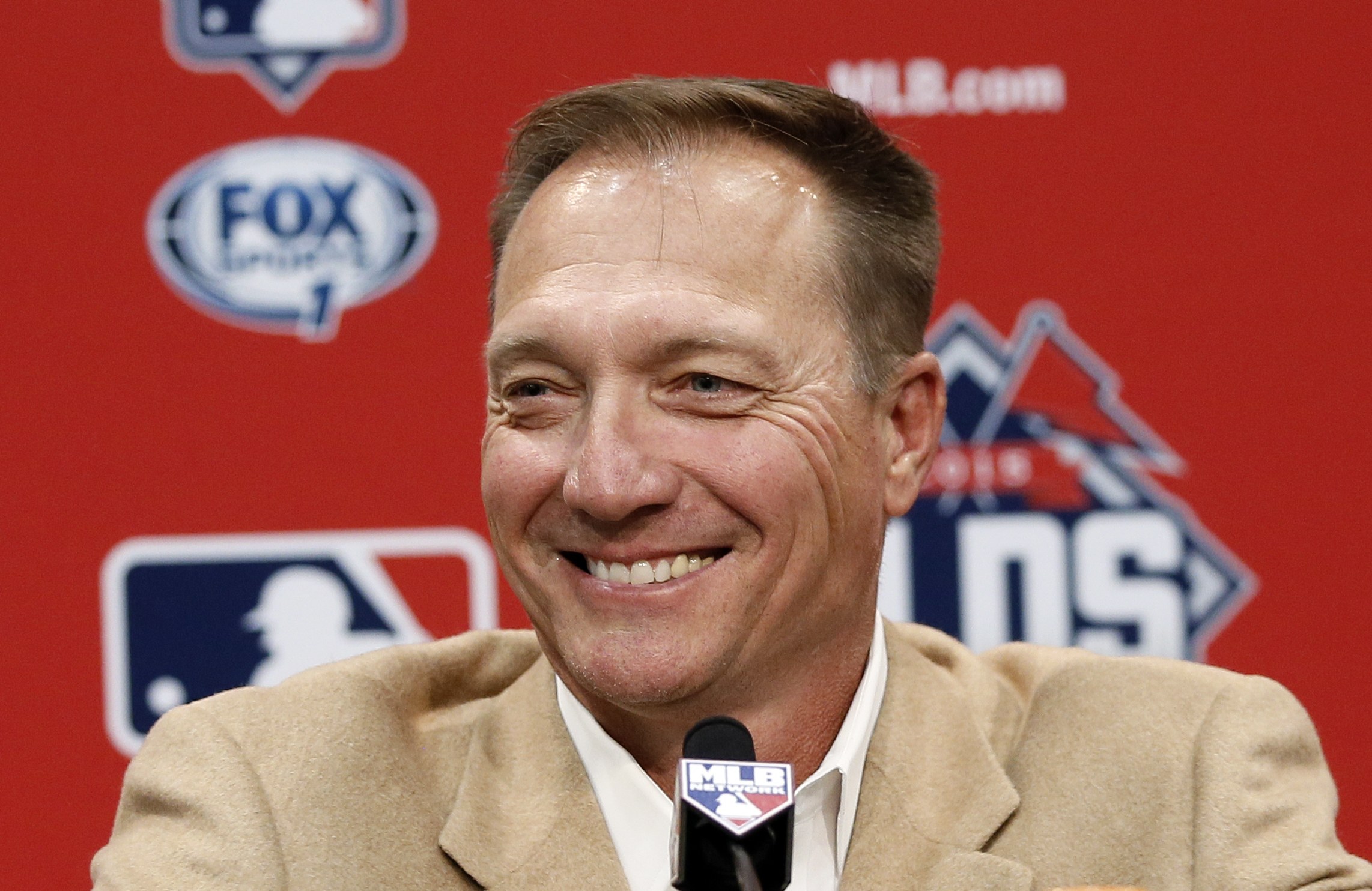 FILE - In this Oct. 13, 2015, file photo, Texas Rangers manager Jeff Banister smiles as he listens to a question during a news conference in Arlington, Texas. Jeff Bannister has been selected the AL Manager of the Year after leading the Texas Rangers to a