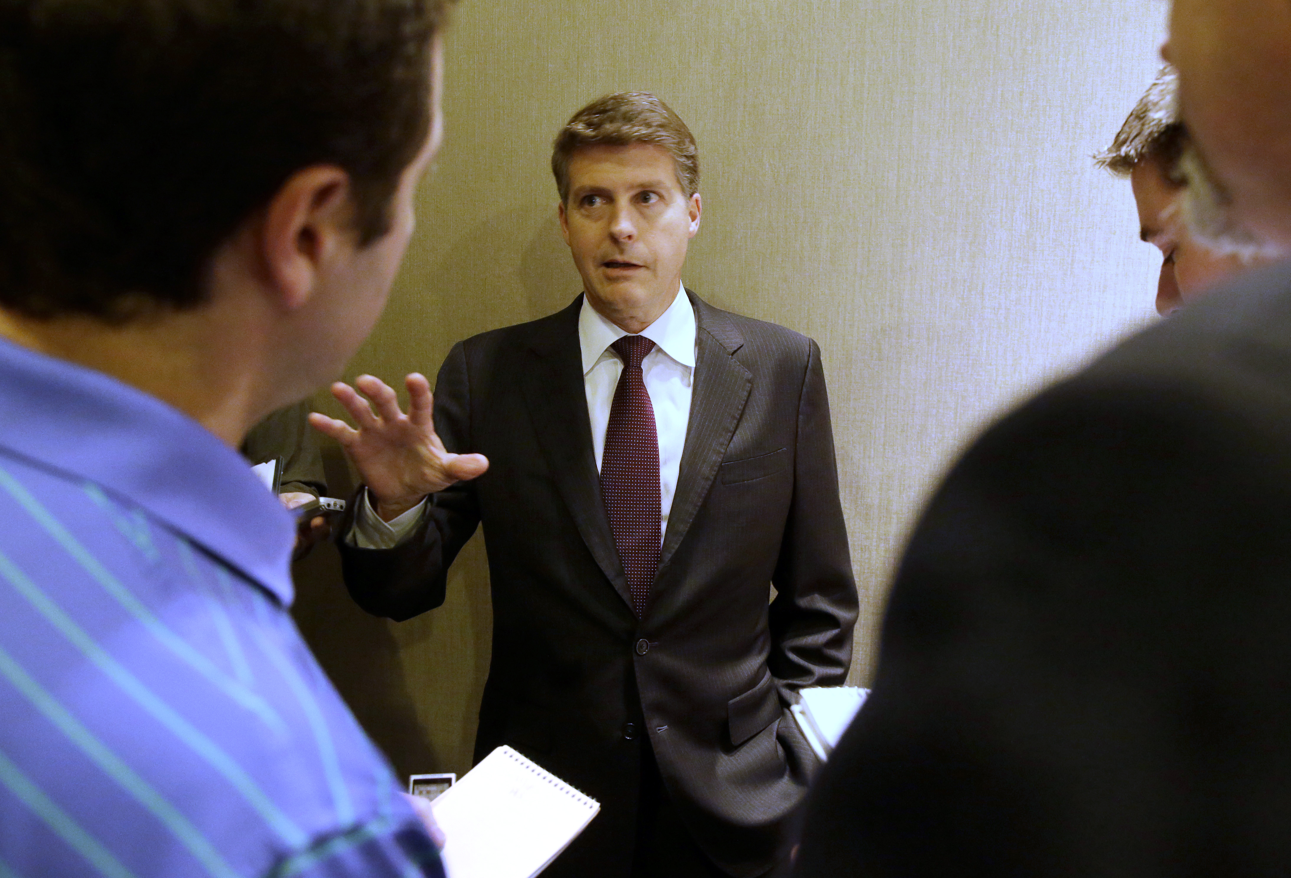 New York Yankees owner Hal Steinbrenner speaks to reporters in the lobby of the hotel hosting the baseball owners meeting, Wednesday, Nov. 18, 2015, in Dallas. (AP Photo/LM Otero)