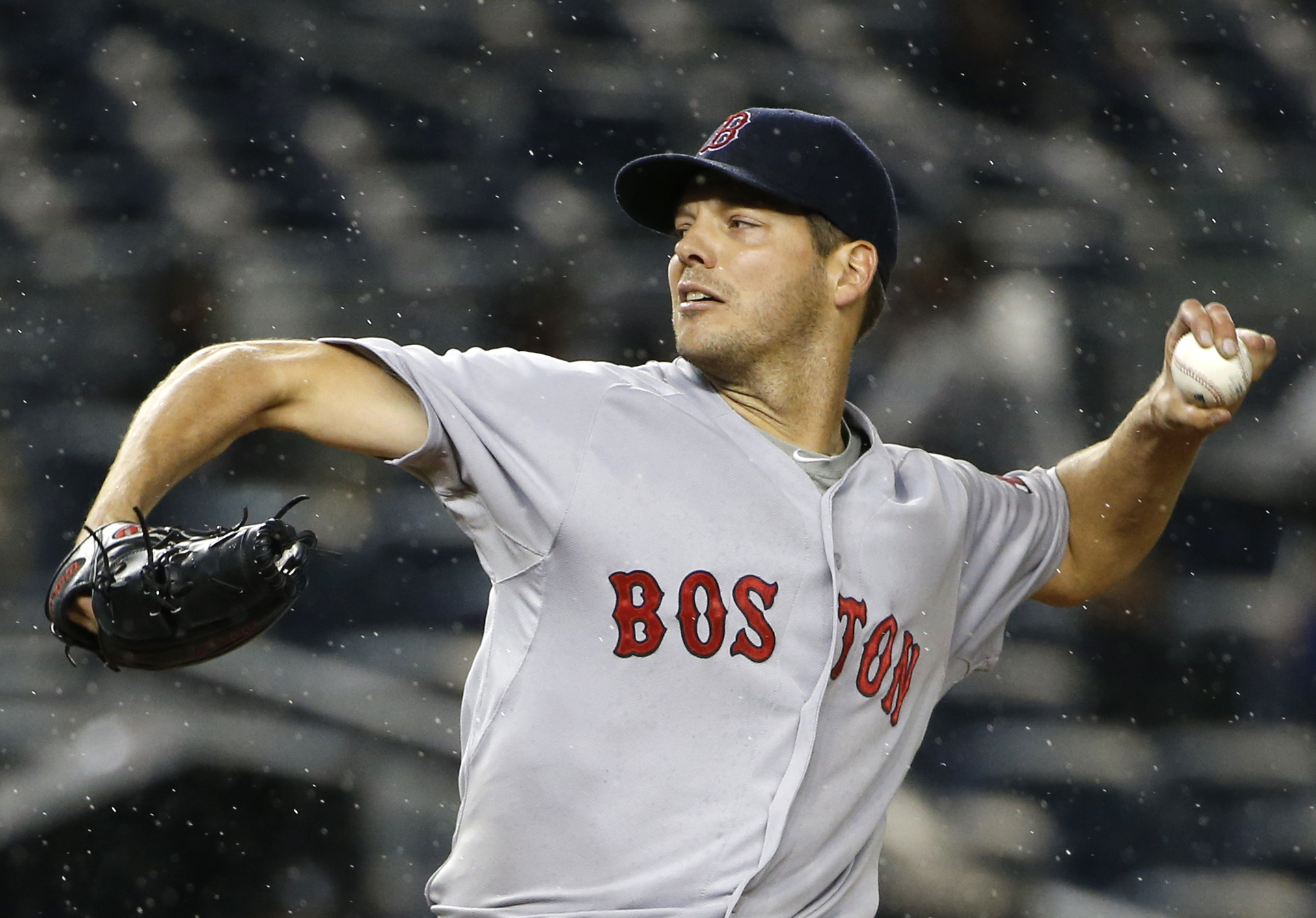 FILE - In this Oct. 1, 2015, file photo, Boston Red Sox starting pitcher Rich Hill delivers in the first inning of a baseball game against the New York Yankees in New York. Left-hander Rich Hill has agreed to a $6 million, one-year contract with the Oakla