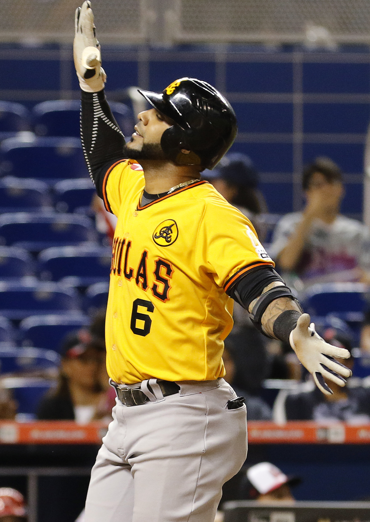 Aguilas' Jonathan Villar reacts as he crosses home plate after his first-inning home run against the Cardenales during the championship Serie de las Americas baseball game at Marlins Park in Miami, Sunday, Nov. 22, 2015. (AP Photo/Joe Skipper)