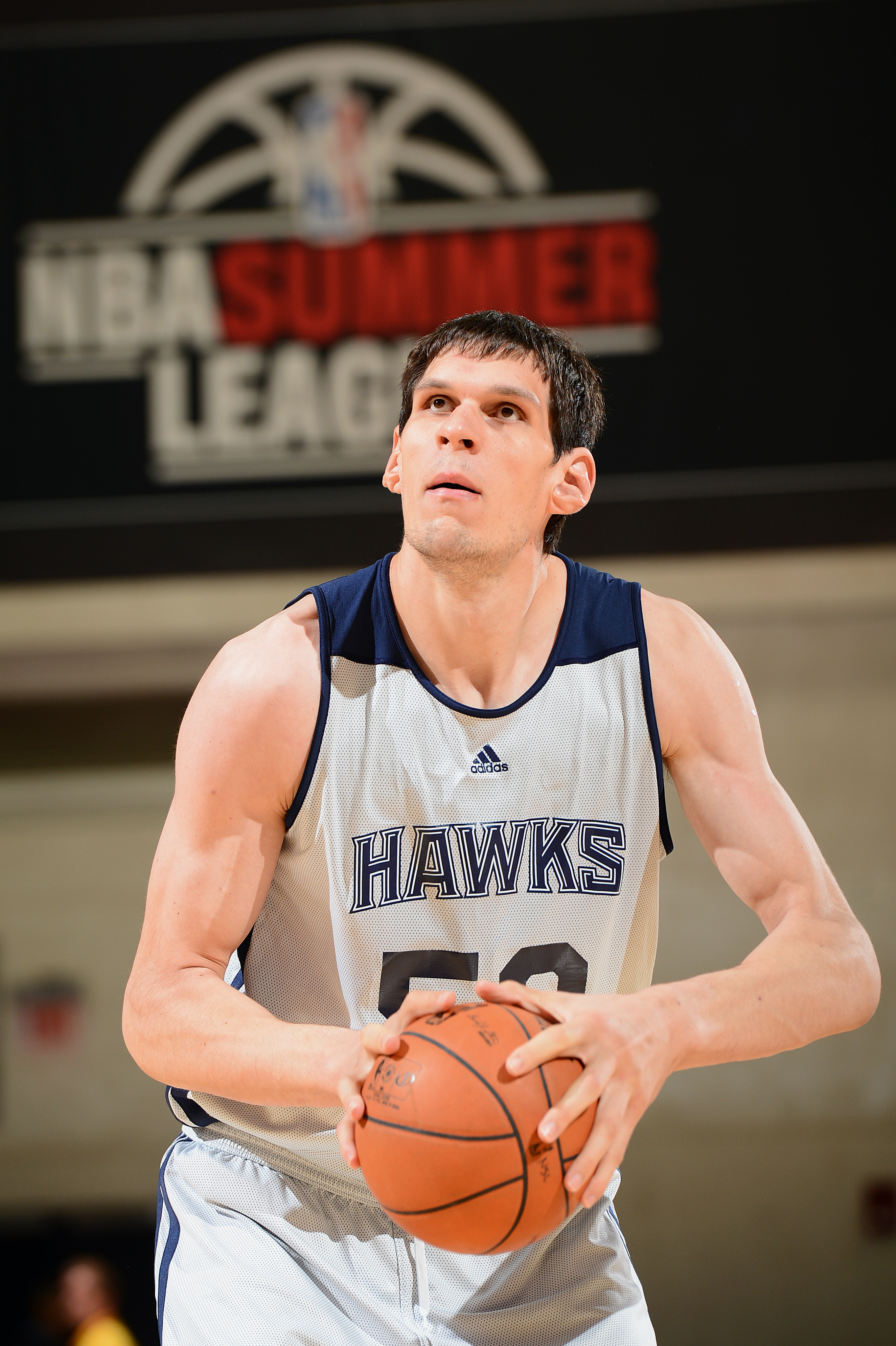 LAS VEGAS, NV - JULY 15: Boban Marjanovic #50 of the Atlanta Hawks goes to shoot the ball against the San Antonio Spurs during NBA Summer League on July 15, 2013 at the Cox Pavilion in Las Vegas, Nevada. (Photo by Garrett W. Ellwood/NBAE via Getty Images)
