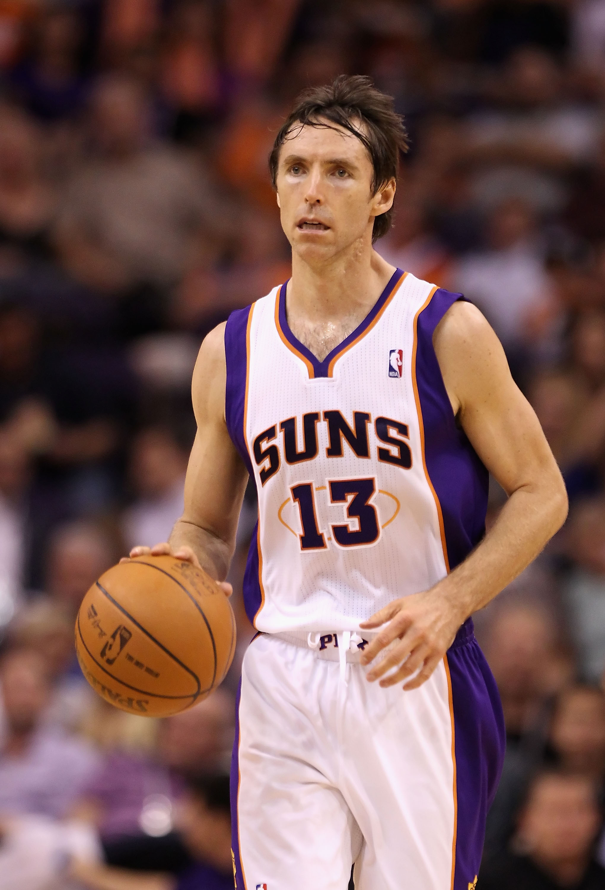 PHOENIX, AZ - APRIL 25:  Steve Nash #13 of the Phoenix Suns moves the ball upcourt during the NBA game against the San Antonio Spurs at US Airways Center on April 25, 2012 in Phoenix, Arizona.  The Spurs defeated the Suns 110-106.  (Photo by Christian Pet