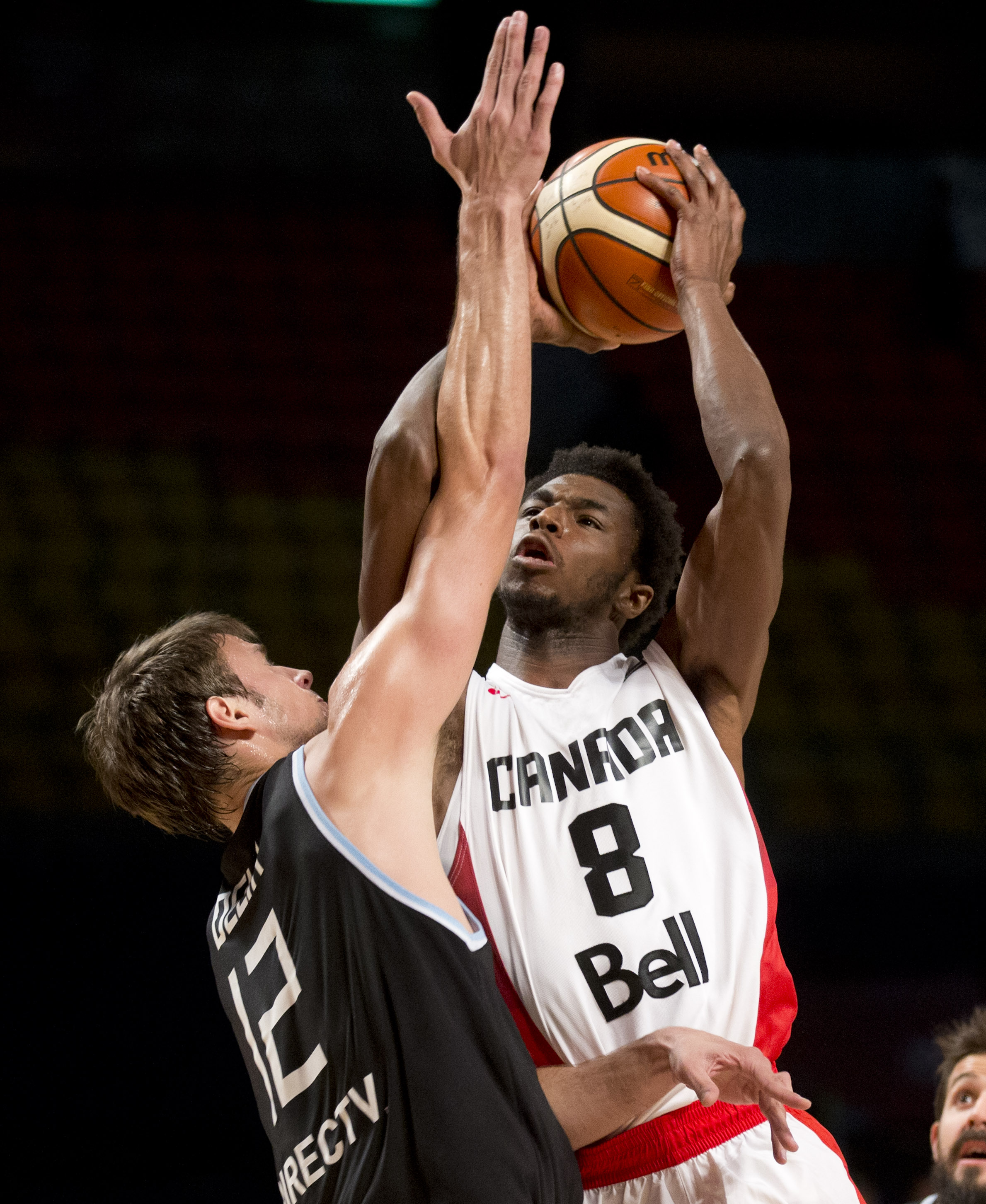 Canada's Andrew Wiggins, right, goes for a shot over Argentina's Marcos Delia during a FIBA Americas Championship basketball game in Mexico City, Tuesday, Sep. 1, 2015. (AP Photo/Eduardo Verdugo)