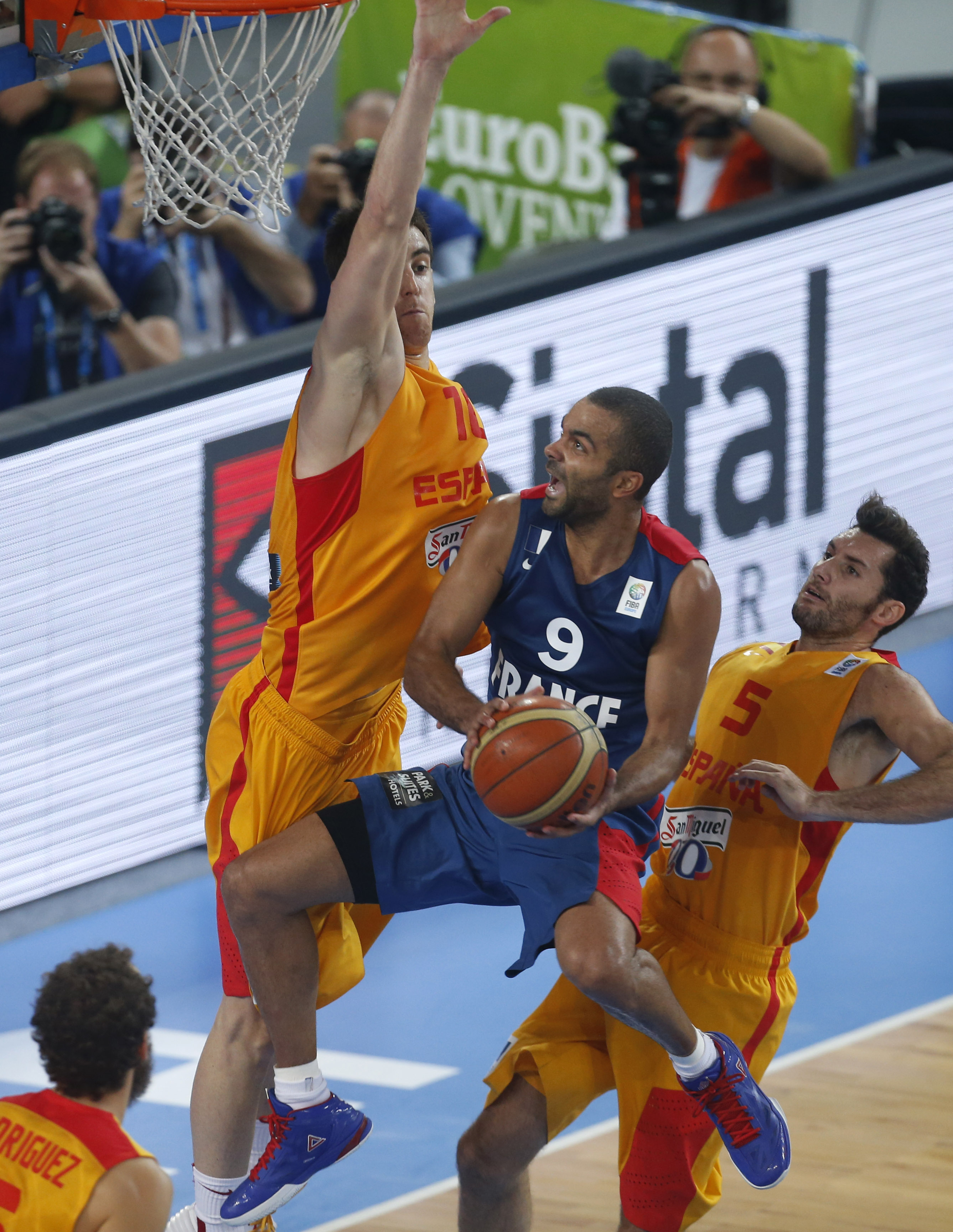 FILE - In this Sept. 20, 2013, file photo, France's Tony Parker, center, challenges for the ball with Spain's Victor Claver, left and Spain's Rudy Fernandez, right, during their EuroBasket European Basketball Championship semifinal match in Ljubljana, Slo