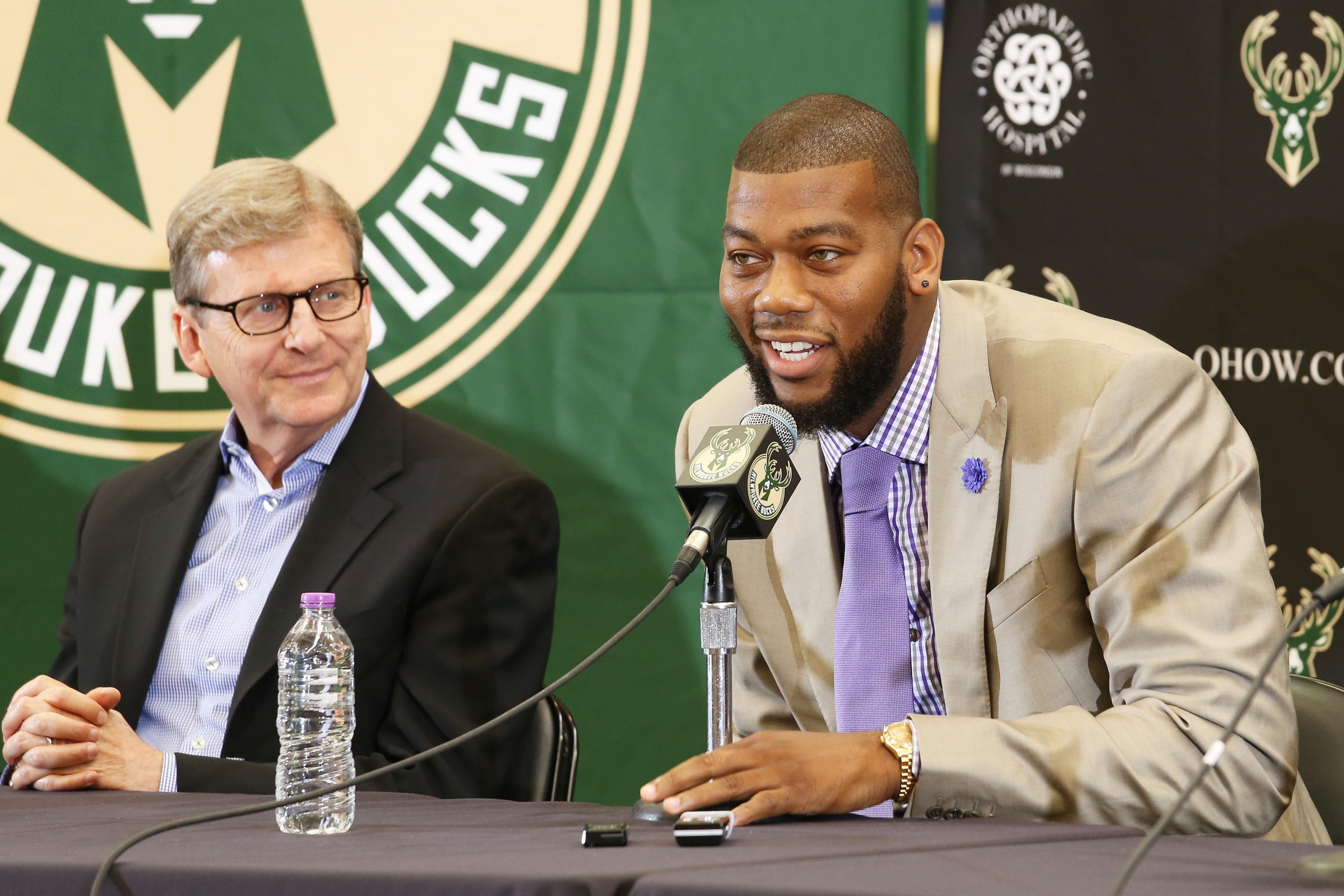 ST. FRANCIS, WI - JULY 9: Recently signed free agents Greg Monroe and Khris Middleton of the Milwaukee Bucks are joined by general manager John Hammond and head coach Jason Kidd during a press conference at the Orthopaedic Hospital of Wisconsin Training C
