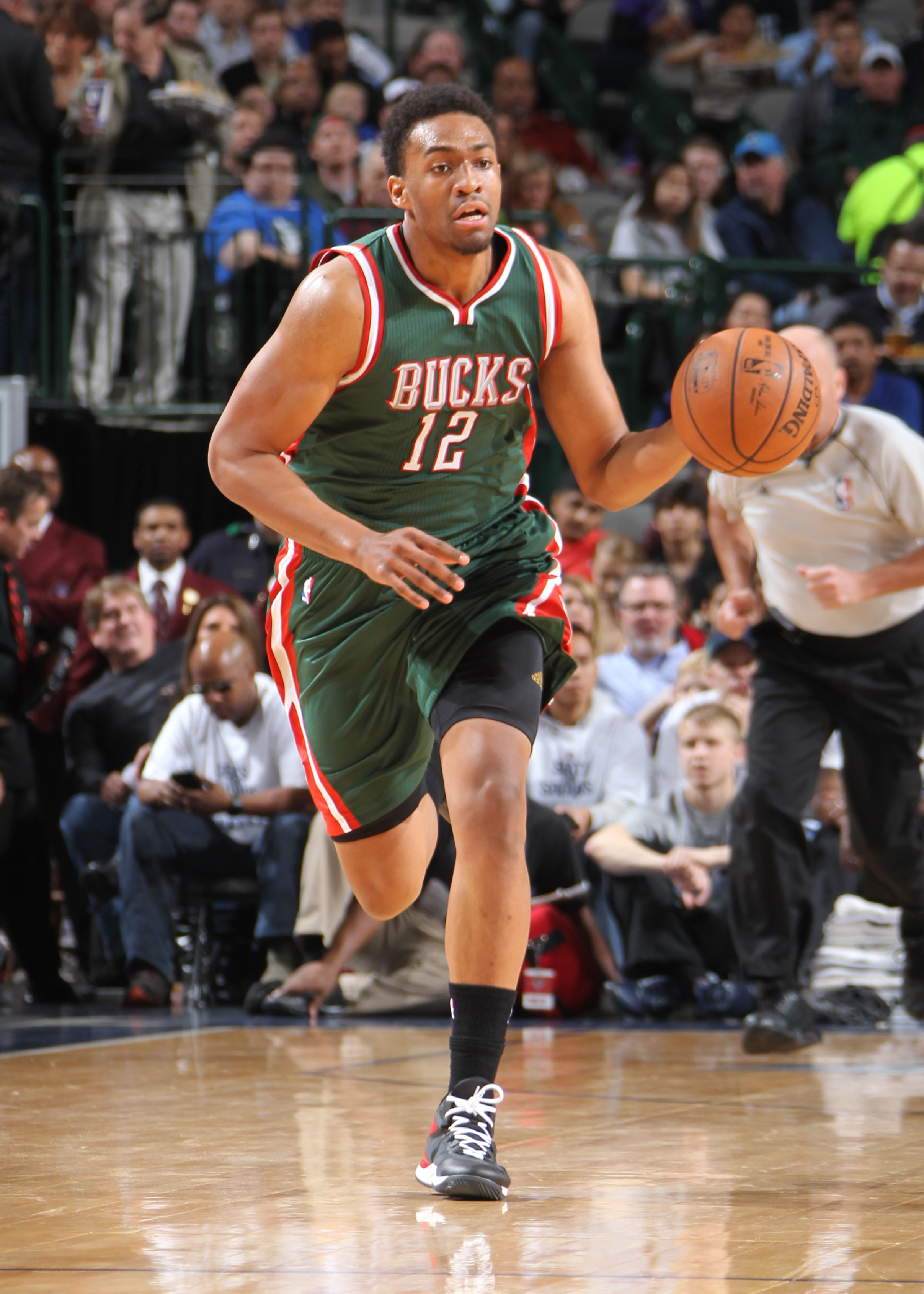 DALLAS, TX - DECEMBER 7: Jabari Parker #12 of the Milwaukee Bucks handles the ball against the Dallas Mavericks on December 7, 2014 at the American Airlines Center in Dallas, Texas. (Photo by Danny Bollinger/NBAE via Getty Images)