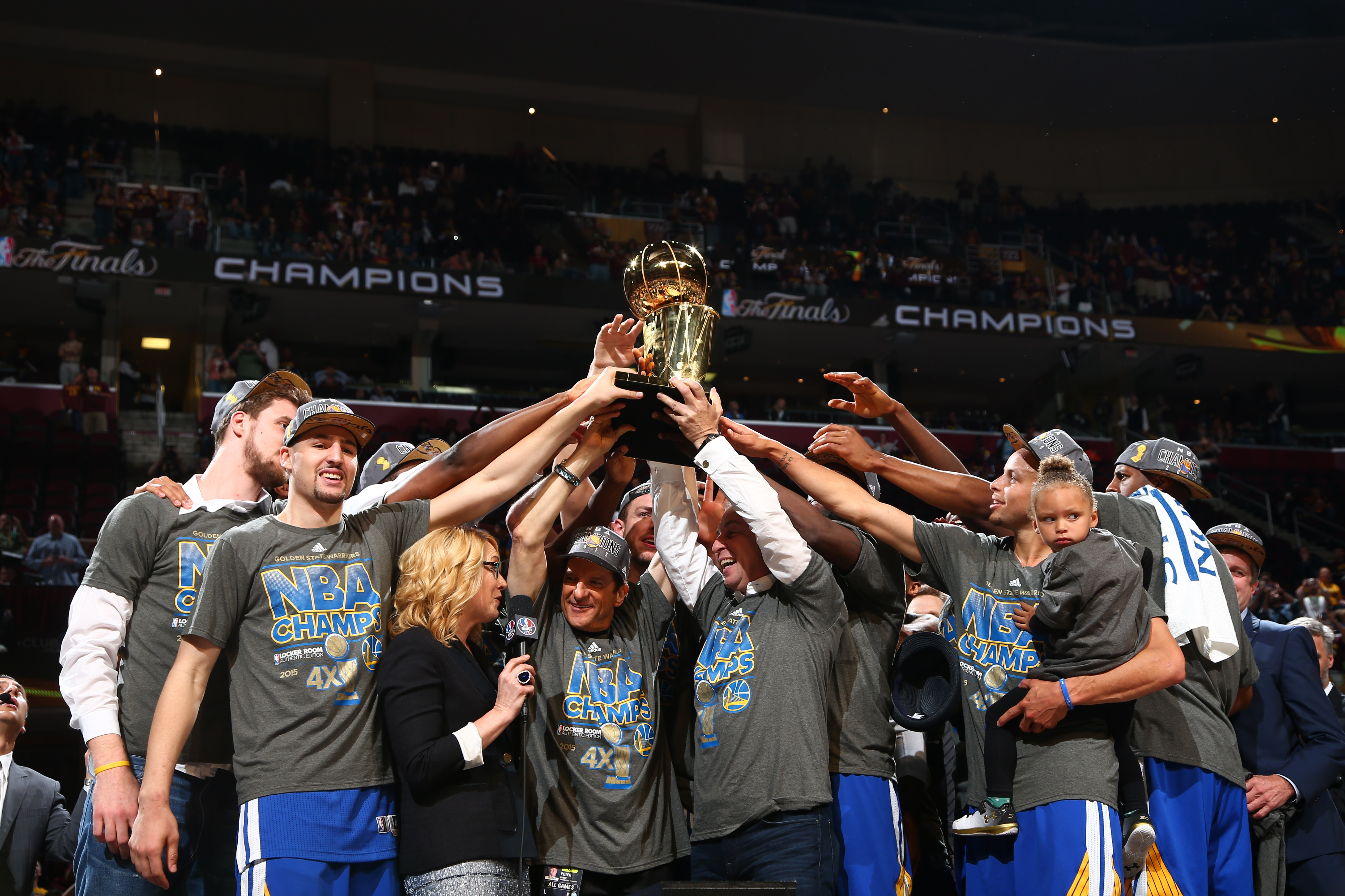 CLEVELAND, OH - JUNE 16:  The Golden State Warriors smile while holding up the Larry O'Brien Championship Trophy after the Golden State Warriors win Game Six of the 2015 NBA Finals at The Quicken Loans Arena on June 16, 2015 in Cleveland, Ohio. (Photo by