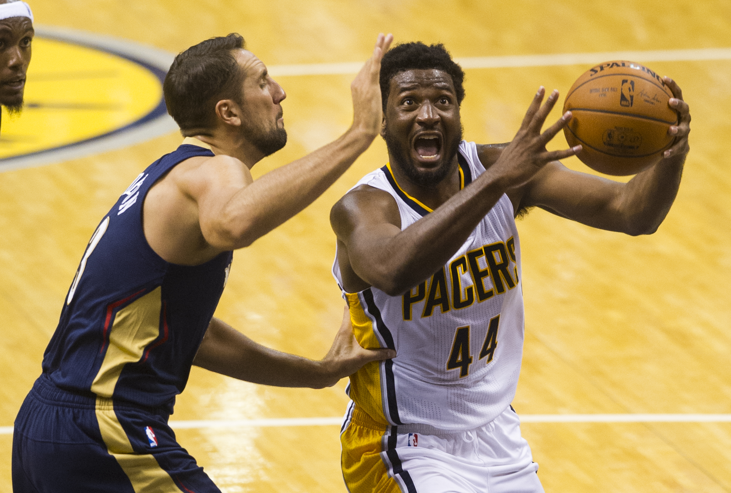 Indiana Pacers' Solomon Hill (44) drives the ball to the basket as he's defended by New Orleans Pelicans' Ryan Anderson (33) during the second half of a preseason NBA basketball game Saturday, Oct. 3, 2015, in Indianapolis. The Pelicans won 110-105. (AP P