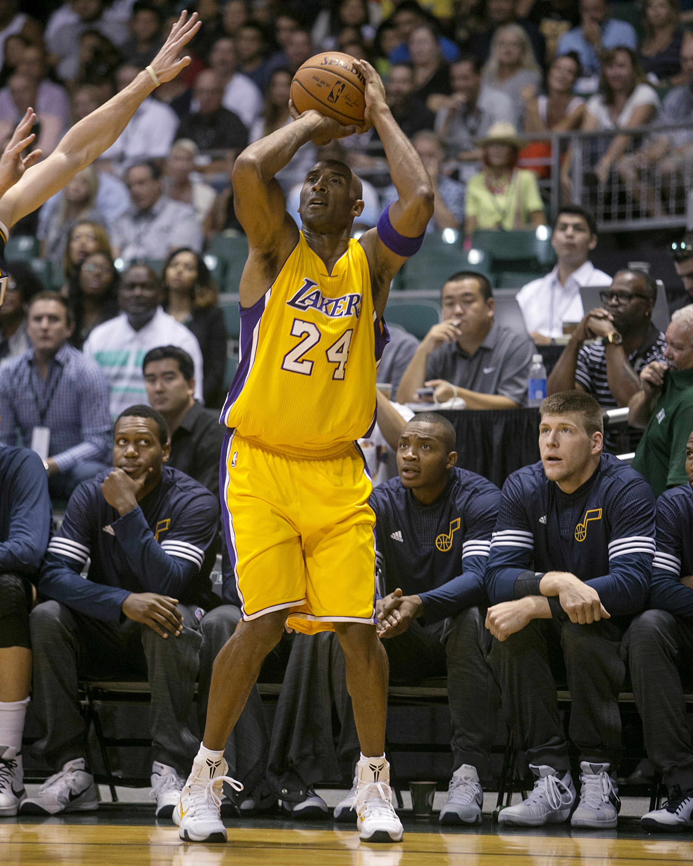 Los Angeles Lakers guard Kobe Bryant (24) attempts a three point shot against Utah during the first quarter of a preseason NBA basketball game, Sunday, Oct. 4. 2015, in Honolulu. (AP Photo/Marco Garcia)