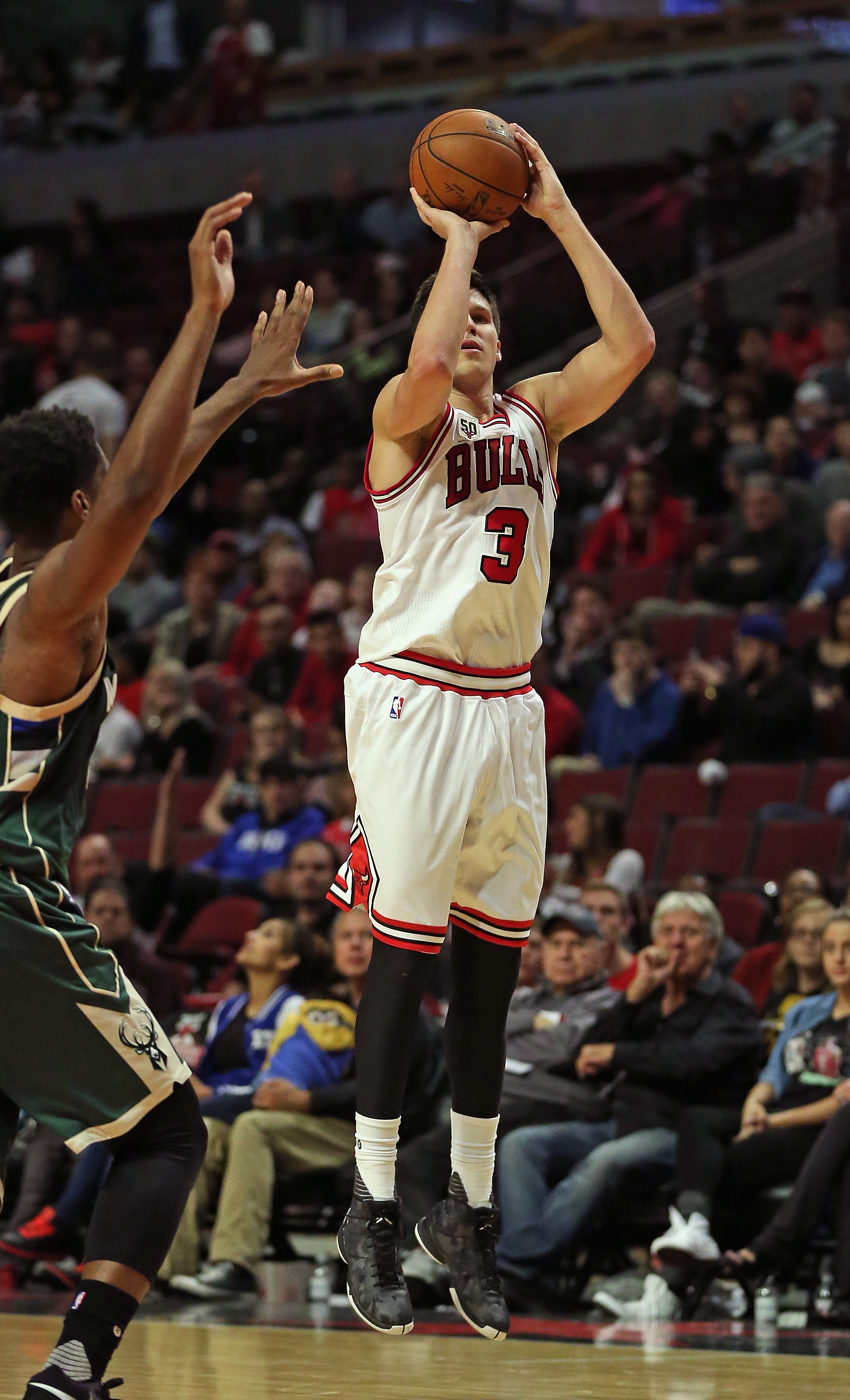 CHICAGO, IL - OCTOBER 06: Doug McDermott #3 of the Chicago Bulls puts up a three-point shot against the Milwaukee Bucks during a preseason game at the United Center on October 6, 2015 in Chicago, Illinois. The Bulls defeated the Bucks 105-95. Note to User