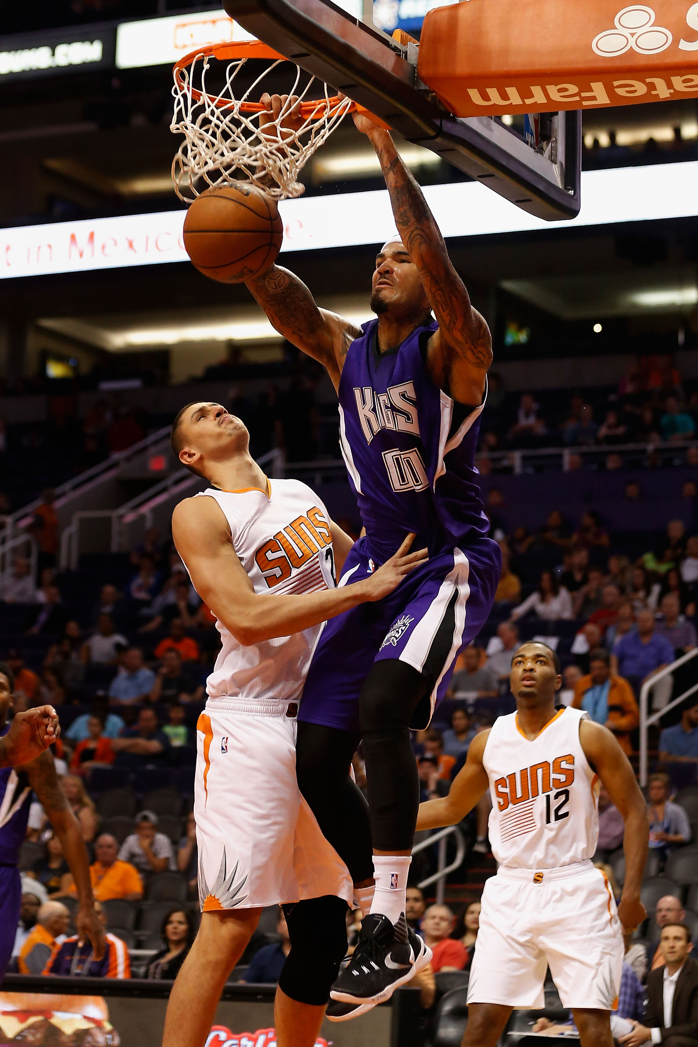 PHOENIX, AZ - OCTOBER 07:  Willie Cauley-Stein #00 of the Sacramento Kings slam dunks the ball over Alex Len #21 of the Phoenix Suns during the first half of the preseason NBA game at Talking Stick Resort Arena on October 7, 2015 in Phoenix, Arizona. (Pho