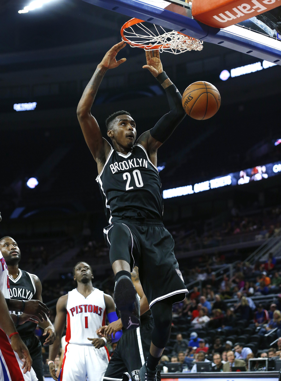 Brooklyn Nets forward Quincy Miller (20) dunks against the Detroit Pistons in the first half of an NBA preseason basketball game in Auburn Hills, Mich., Thursday, Oct. 8, 2015. (AP Photo/Paul Sancya)