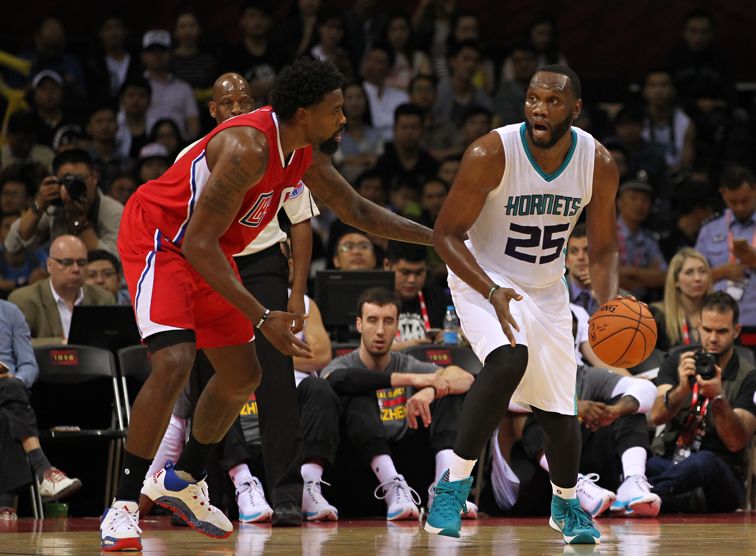 SHENZHEN, CHINA - OCTOBER 11: Al Jefferson #25 of Charlotte Hornets in action against Deandre Jordan #6 of Los Angeles Clippers during the match between Charlotte Hornets and Los Angeles Clippers  as part of the 2015 NBA Global Games China at Universiade