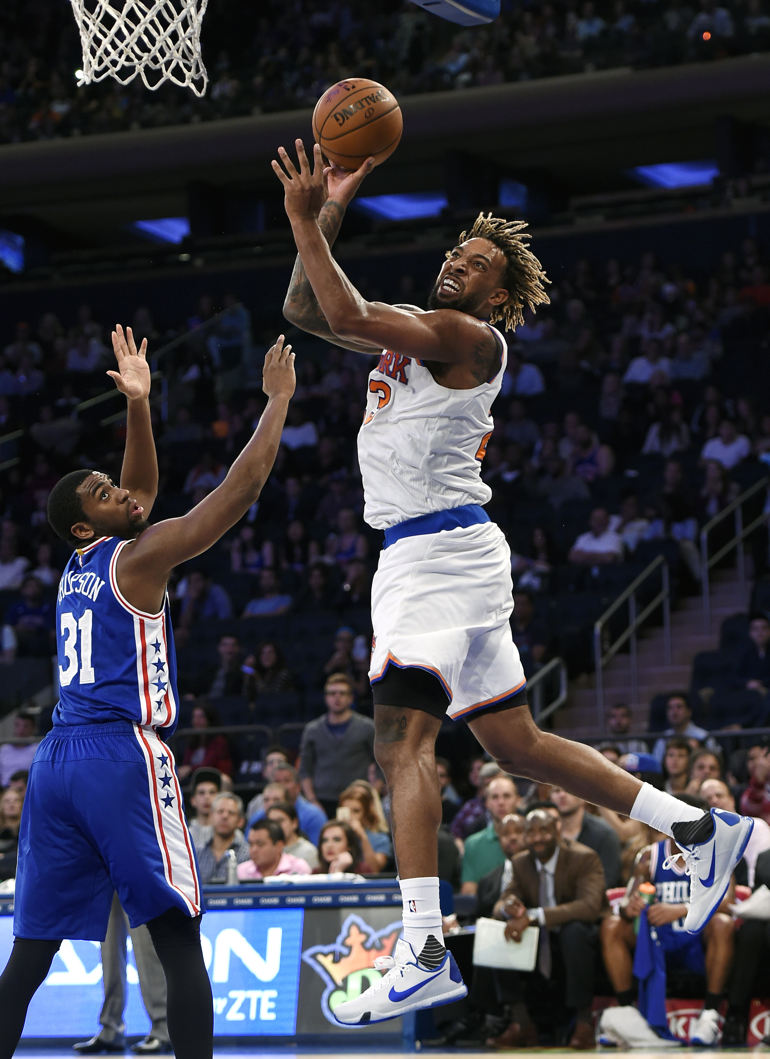 New York Knicks forward Derrick Williams (23) takes aim for the basket over Philadelphia 76ers guard Hollis Thompson (31) during the second half of a preseason NBA basketball game on Monday, Oct. 12, 2015, in New York. The Knicks won 94-88. (AP Photo/Kath