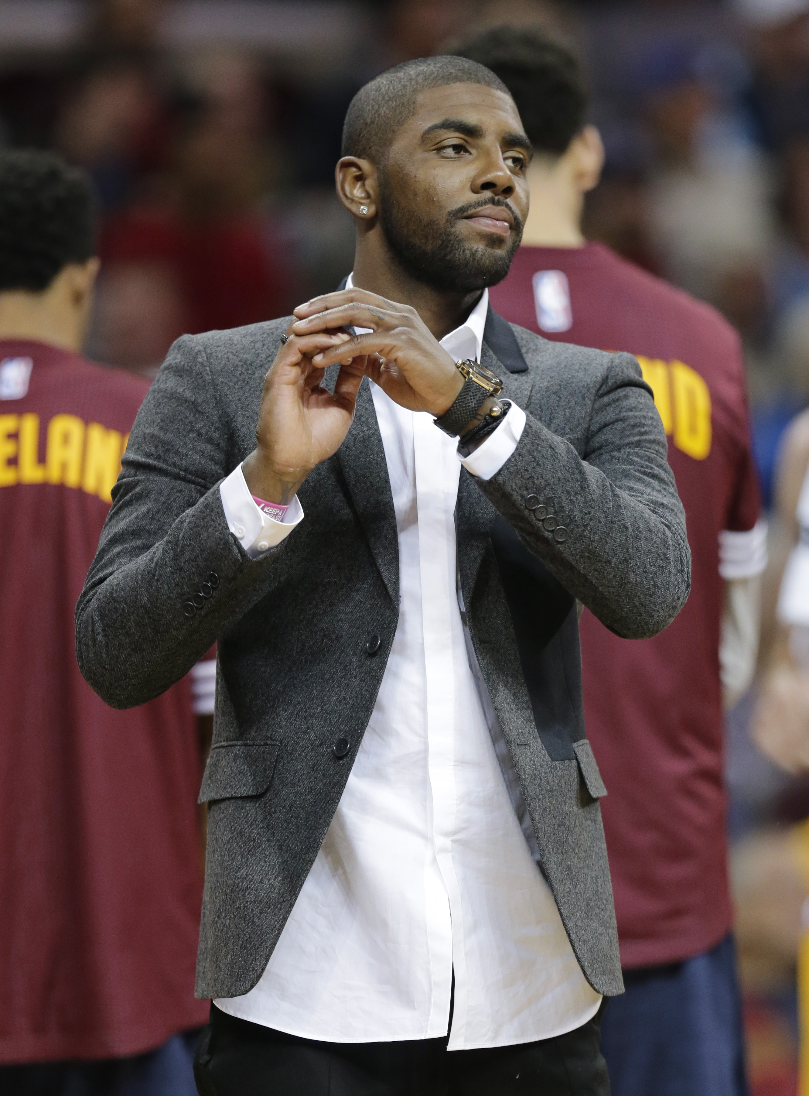 Cleveland Cavaliers' Kyrie Irving is shown during a timeout in the first half of an NBA basketball game against the Milwaukee Bucks Tuesday, Oct. 13, 2015, in Cleveland. (AP Photo/Tony Dejak)